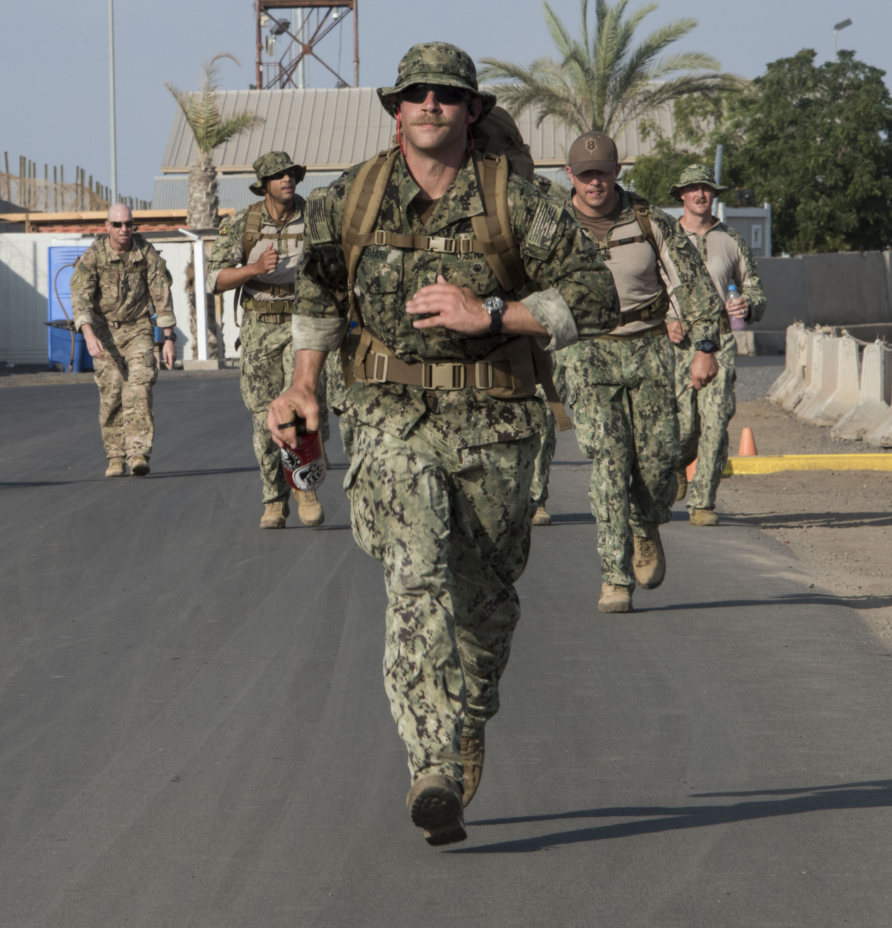 U.S. service members assigned to Combined Joint Task Force-Horn of Africa complete a ruck march as part of the competition to earn the German Armed Forces Proficiency Badge (GAFPB), a decoration of the Armed Forces of the Federal Republic of Germany, at Camp Lemonnier, Djibouti, Nov. 30, 2017. Competitors must complete a physical fitness test, uniformed swim, weapons qualification, ruck march, first aid course and chemical warfare course to be awarded the GAFPB, one of the few foreign allied military awards that U.S. service members are authorized to wear. (U.S. Air National Guard photo by Staff Sgt. Allyson L. Manners)
