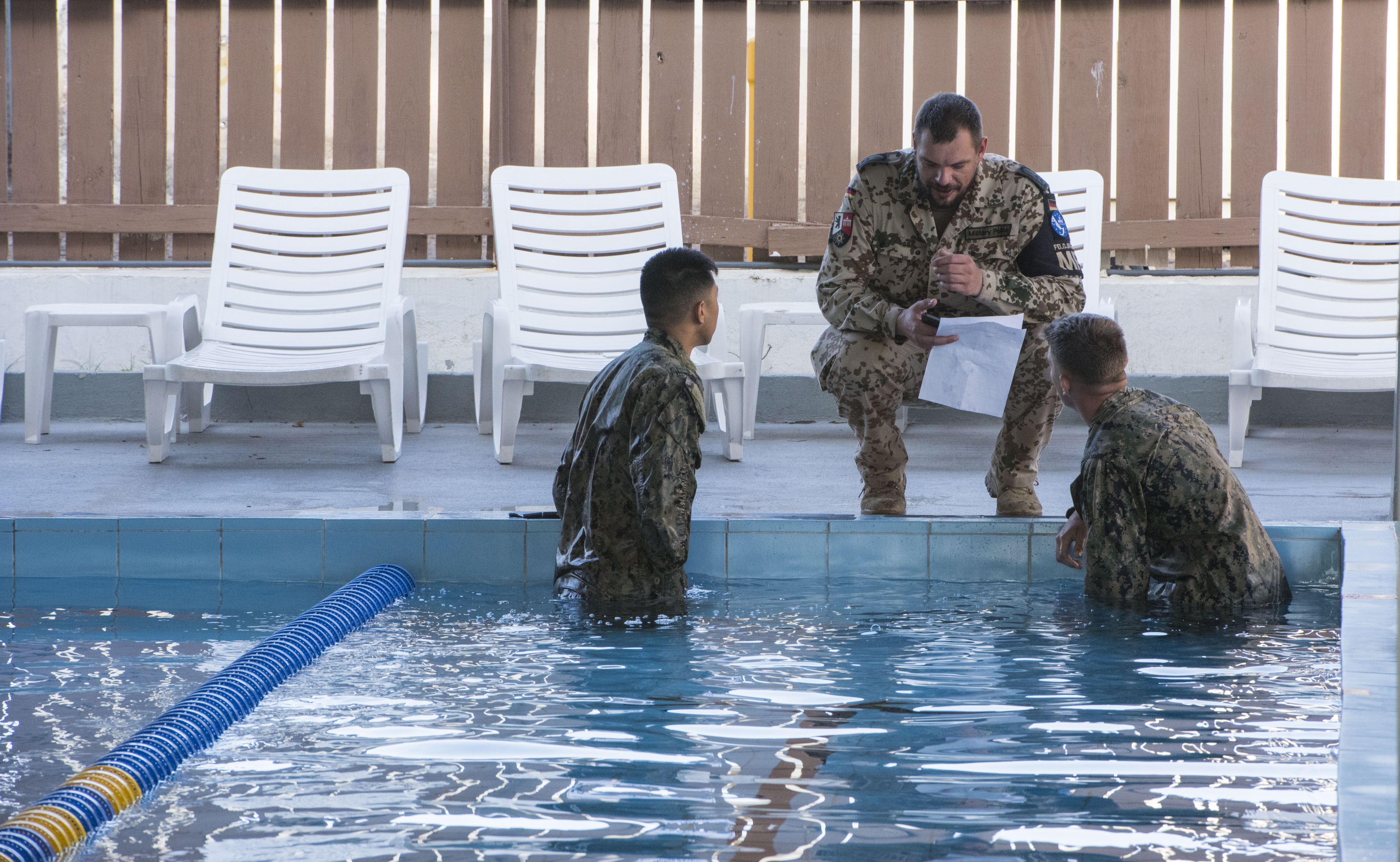 U.S. service members assigned to Combined Joint Task Force-Horn of Africa complete a swim test in uniform as part of the competition to earn the German Armed Forces Proficiency Badge (GAFPB), a decoration of the Armed Forces of the Federal Republic of Germany, at Camp Lemonnier, Djibouti, Nov 28, 2017. Competitors must complete a physical fitness test, uniformed swim, weapons qualification, ruck march, first aid course and chemical warfare course to be awarded the GAFPB, one of the few foreign allied military awards that U.S. service members are authorized to wear. (U.S. Air National Guard photo by Staff Sgt. Allyson L. Manners)