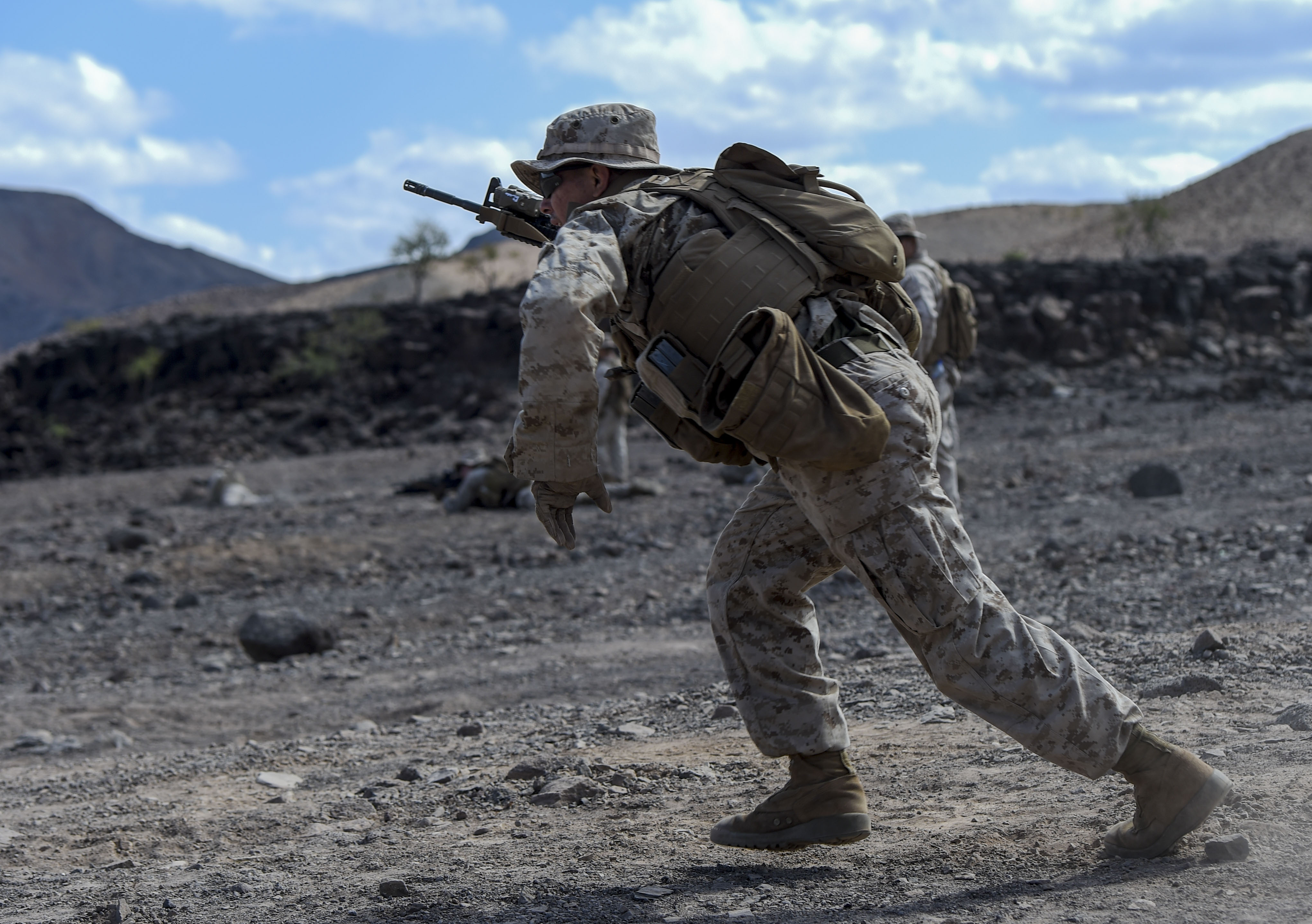 A U.S. Marine with the 15th Marine Expeditionary Unit runs into position during a fire team movement rehearsal during Alligator Dagger at Arta Range, Djibouti, Dec. 15, 2017. Alligator Dagger, led by Naval Amphibious Force, Task Force 51/5th Marine Expeditionary Brigade, is a dedicated, bilateral combat rehearsal that combines U.S. and French forces to practice, rehearse and exercise integrated capabilities available to U.S. Central Command both afloat and ashore. (U.S. Air Force photo by Staff Sgt. Timothy Moore)