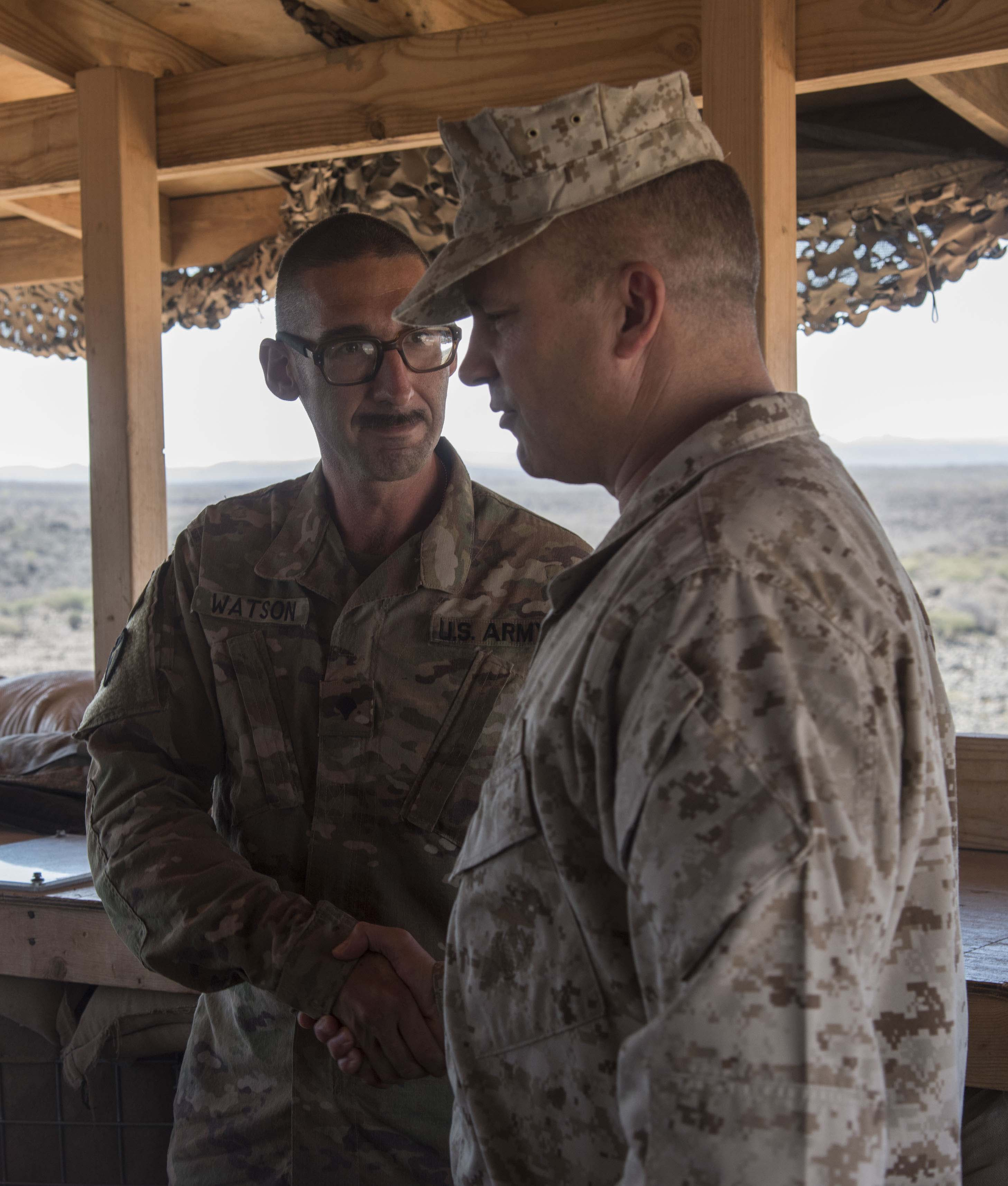 U.S. Army Specialist Douglas L. Watson, Jr., with the 3rd Battalion, 144th Infantry Regiment, assigned to Task Force Bayonet, Combined Joint Task Force - Horn of Africa, shakes hands with U.S. Marine Corps Brig. Gen. David J. Furness, commander of CJTF-HOA, in Chebelley, Djibouti, Dec. 25, 2017.  Furness spent the afternoon  meeting with service members and thanking them for their continued service and sacrifice throughout the holiday season. (U.S. Air National Guard photo by Staff Sgt. Allyson L. Manners)