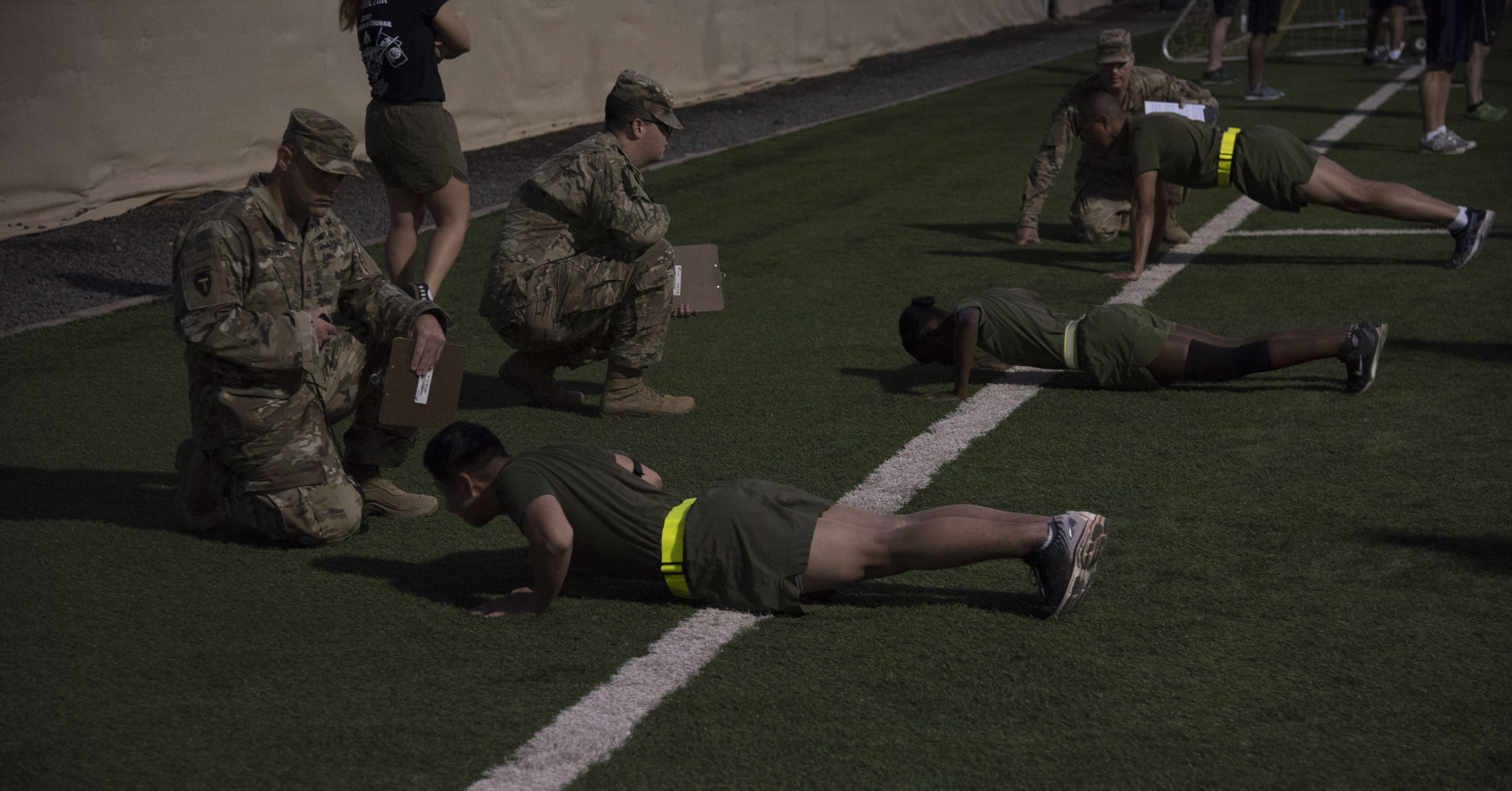 U.S. Army Non-Commissioned Officers administer an Army physical fitness test as part of the Joint Corporals Course hosted by Combined Joint Task Force – Horn of Africa at Camp Lemonnier, Jan. 13, 2018. The Joint Corporals Course is designed to provide junior service members with the knowledge and skills necessary to assume leadership roles of greater responsibility as a non-commissioned officer, as well as strengthen bonds between participating militaries. (U.S. Air National Guard photo by Staff Sgt. Allyson L. Manners)