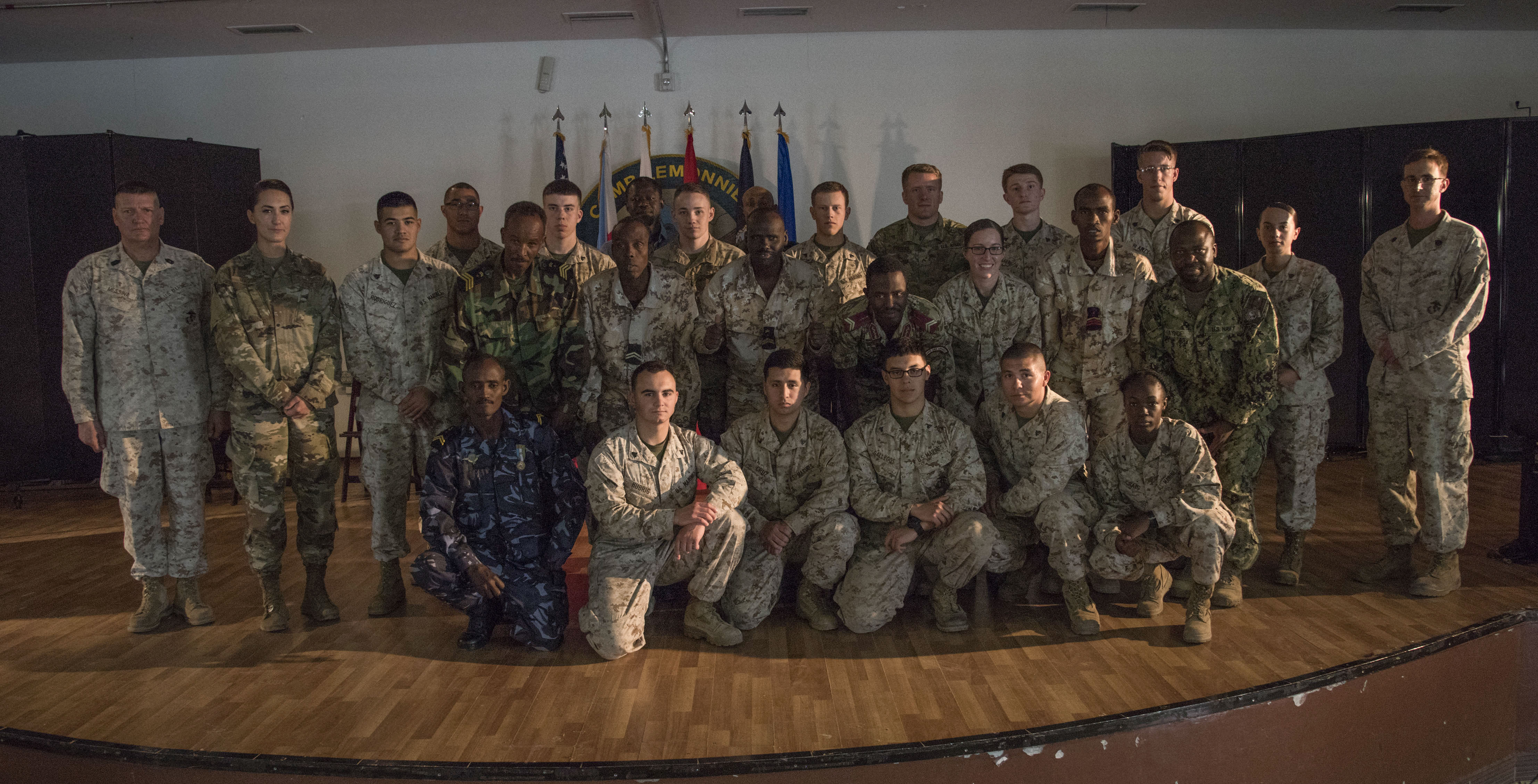 U.S. Marines, Soldiers and Sailors and Djiboutian military members pose for a group photo after graduating the Joint Corporals Course, hosted by Combined Joint Task Force – Horn of Africa at Camp Lemonnier, Jan. 24, 2018. The Joint Corporals Course is designed to provide junior service members with the knowledge and skills necessary to assume leadership roles of greater responsibility as a non-commissioned officer, as well as strengthen bonds between participating militaries. (U.S. Air National Guard photo by Staff Sgt. Allyson L. Manners)