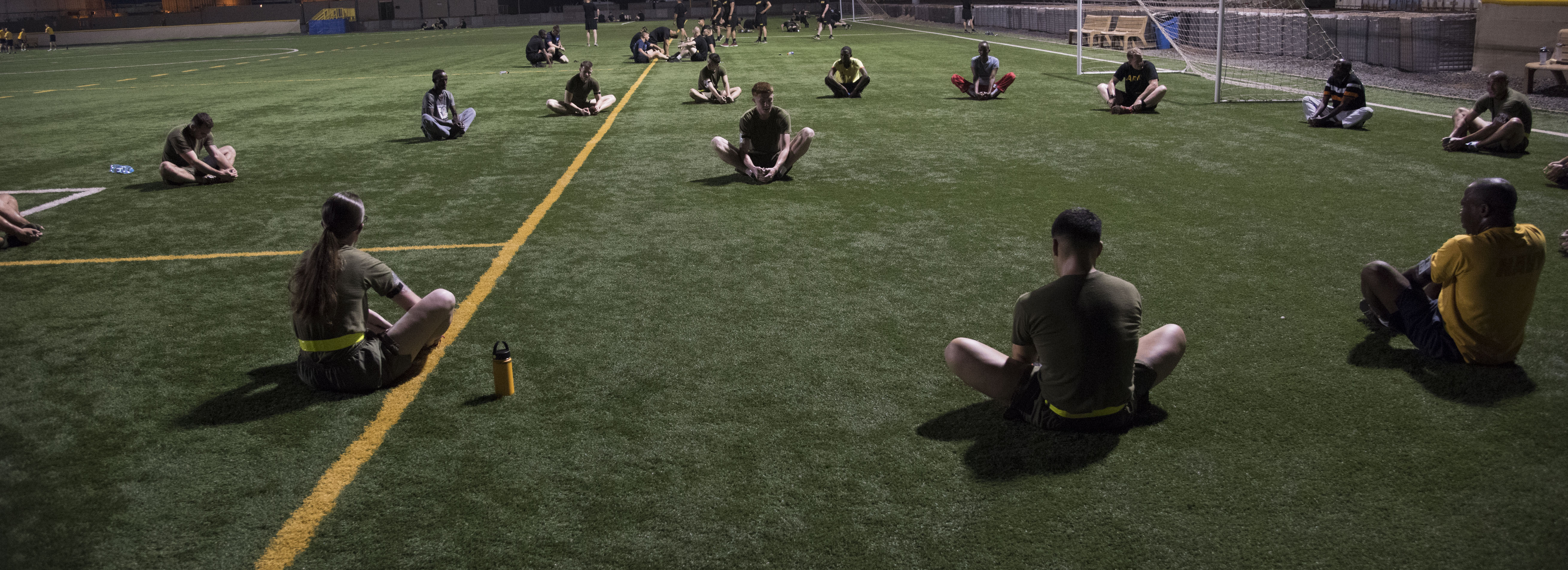 U.S. Marines, Sailors and Soldiers and Djiboutian military members stretch on the turf field of Camp Lemonnier, Djibouti, before beginning a physical fitness test as part of the Joint Corporals Course, hosted by Combined Joint Task Force – Horn of Africa, Jan. 9, 2018. The Joint Corporals Course is designed to provide junior service members with the knowledge and skills necessary to assume leadership roles of greater responsibility as a non-commissioned officer, as well as strengthen bonds between participating militaries. (U.S. Air National Guard photo by Staff Sgt. Allyson L. Manners)