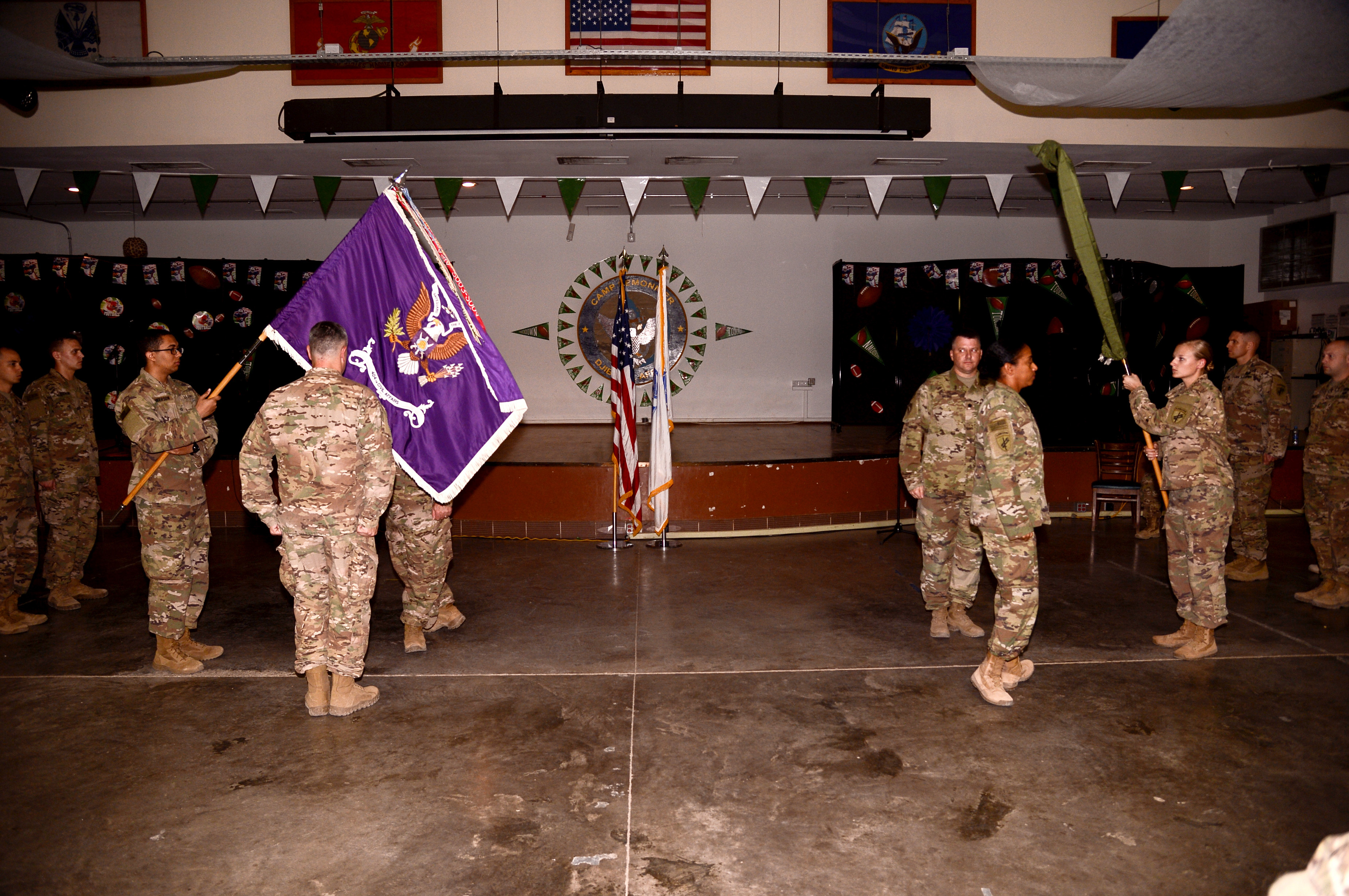 The U.S. Army 443rd Civil Affairs Battalion retires their colors as the 404th Civil Affairs Battalion raises theirs during a transfer of authority ceremony at Camp Lemonnier, Djibouti, Feb. 3, 2018. The 404th will conduct military-to-military engagements to strengthen partner nation capacity and relationships with local military forces, civilian populations and civilian authorities. They also advise the Combined Joint Task Force Horn of Africa commanding general on the civil environment. (U.S. Navy Photo by Mass Communication Specialist 2nd Class Timothy M. Ahearm)