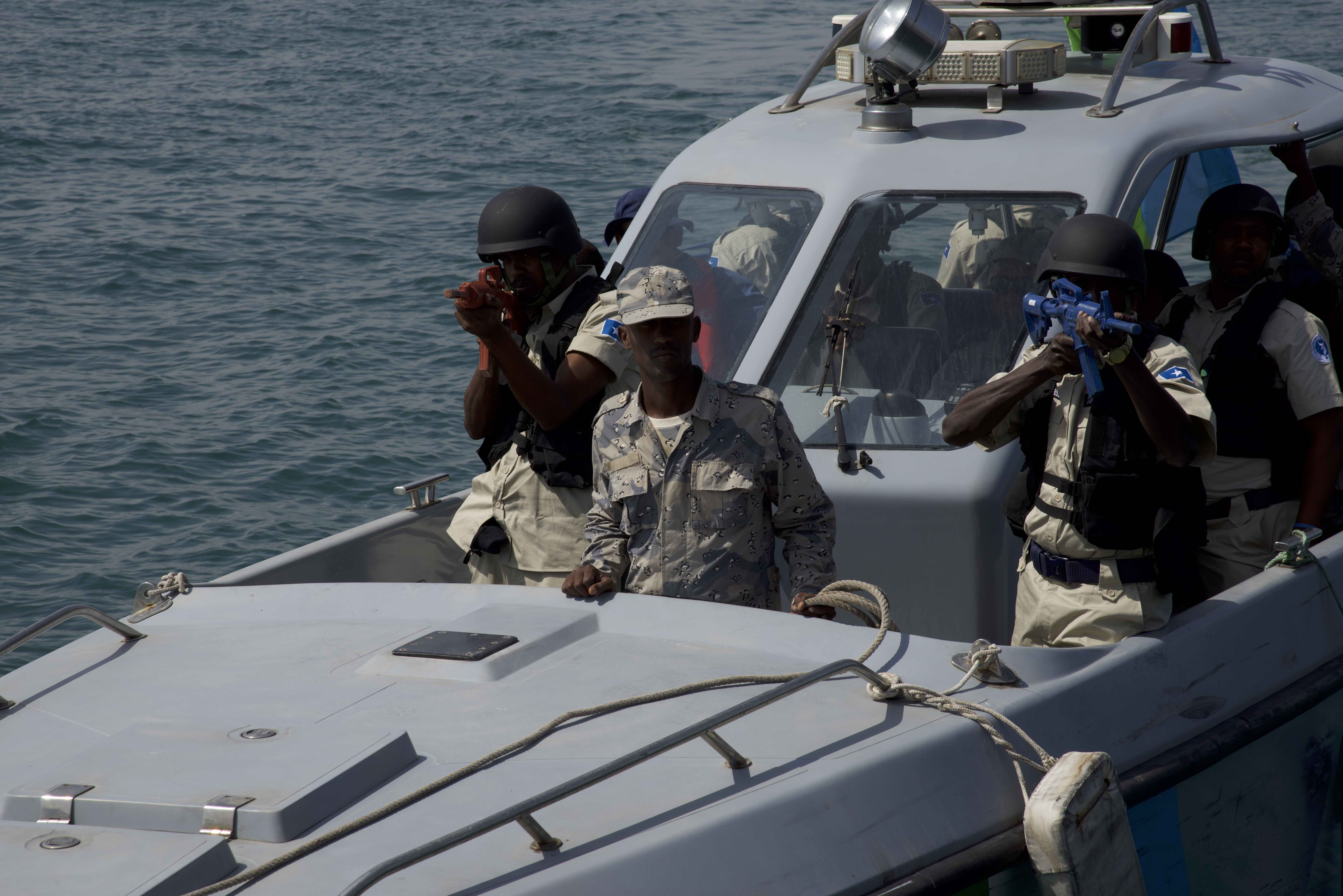 Members of the Somali maritime police and Djibouti coast guard participate in a visit, board, search and seizure drill (VBSS) during exercise Cutlass Express 2018 in the Port of Djibouti Feb. 5, 2018. Cutlass Express is designed to improve cooperation, maritime domain awareness and information sharing practices to increase capabilities between the U.S., East African and Western Indian Ocean nations. (U.S. Air National Guard photo by Staff Sgt. Allyson Manners)