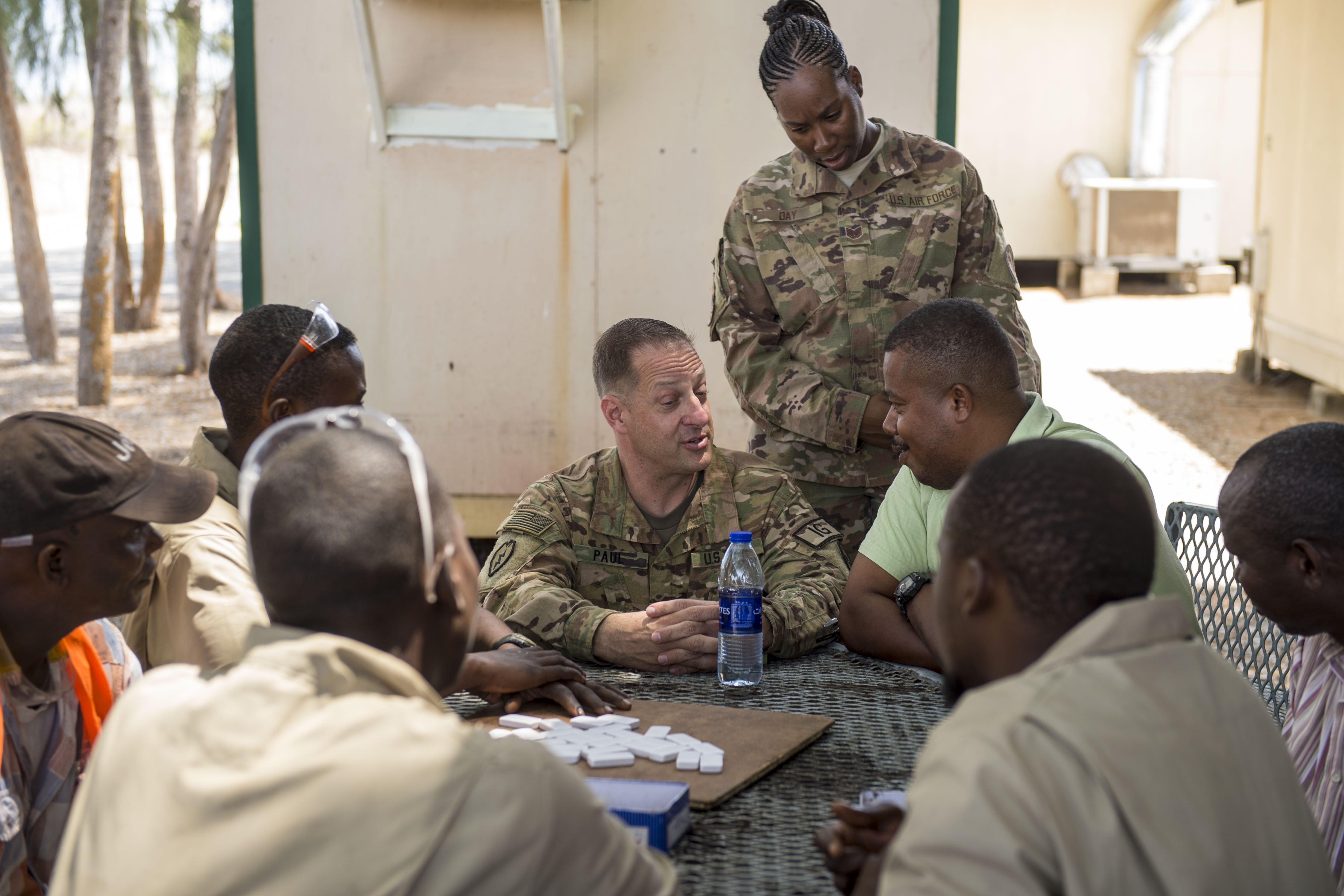 U.S. Army Maj. Robert T. Paul, command inspector general, and U.S. Air Force Tech. Sgt. Starr Day, assistant inspector general, talk with local national contractors during a battlefield circulation site visit at Camp Simba in Manda Bay, Kenya, Feb. 24, 2018. While assigned to the Combined Joint Task Force - Horn of Africa Inspector General directorate, Paul and Day provide support to the service members, Department of Defense civilians, and local national and third-country national contractors who work on the camp. Though many of the members at the camp don't fall under CJTF-HOA's command, many of the concerns that affect the CJTF-HOA personnel also affect them and vice versa. (U.S. Air Force photo by Staff Sgt. Timothy Moore)