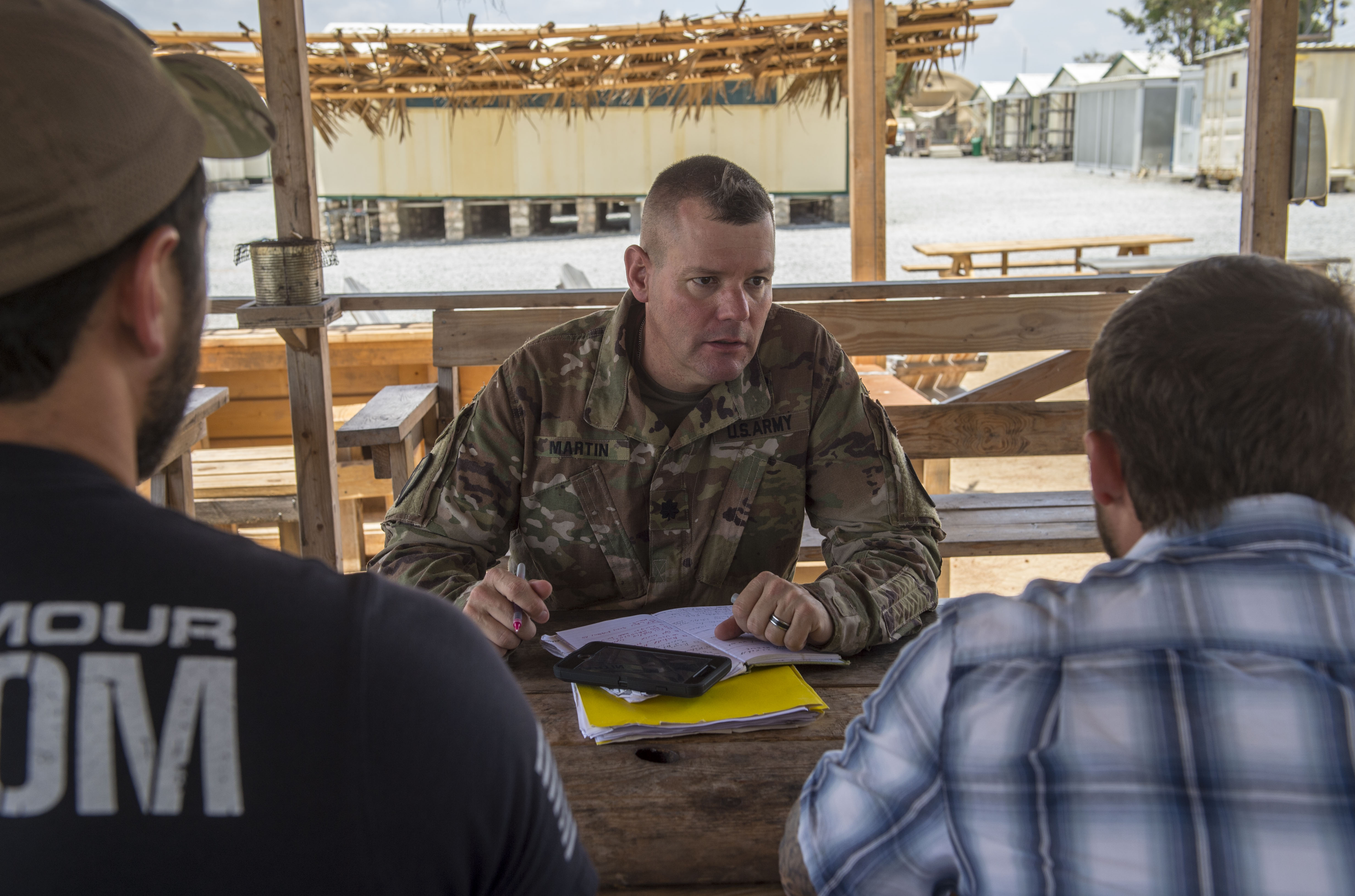 U.S. Army Lt. Col. Todd Martin, left, safety officer assigned to the Combined Joint Task Force - Horn of Africa (CJTF-HOA) Safety directorate, speaks with CJTF-HOA personnel assigned to Camp Simba in Manda Bay, Kenya, about safety concerns during a battlefield circulation site visit Feb. 24, 2018. The CJTF-HOA Safety and Inspector General directorates provide support to the service members, Department of Defense civilians, and local national and third-country national contractors who work on the camp. Though many of the members at the camp don't fall under CJTF-HOA, many of the concerns that affect the CJTF-HOA personnel also affect them and vice versa. (U.S. Air Force photo by Staff Sgt. Timothy Moore)