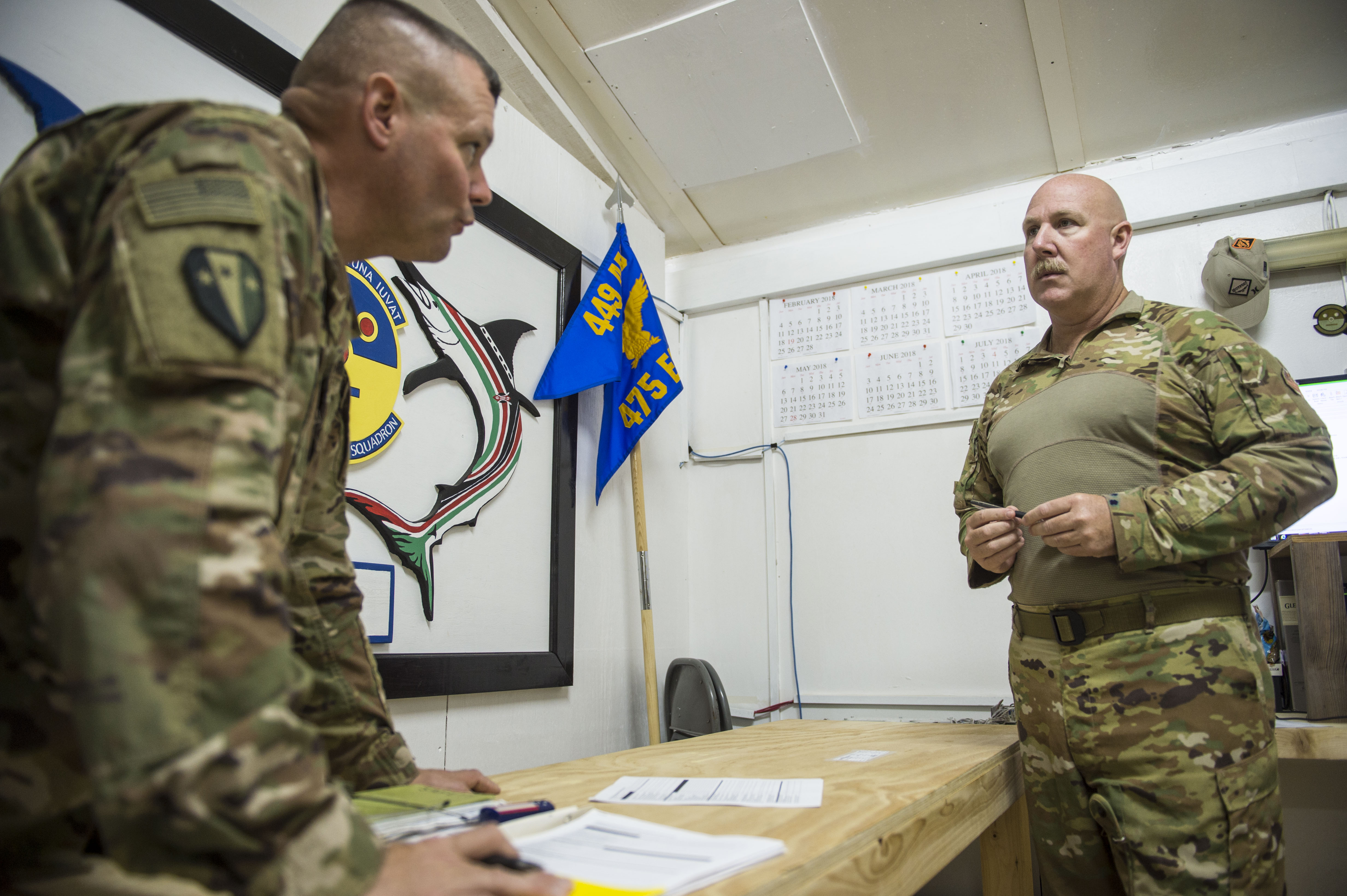 U.S. Army Lt. Col. Todd Martin, left, safety officer assigned to the Combined Joint Task Force - Horn of Africa (CJTF-HOA) Safety directorate, speaks with U.S. Air Force Lt. Col. Vance Goodfellow, 475th Expeditionary Air Base Squadron (EABS) commander, about a safety inspection he performed during a battlefield circulation site visit at Camp Simba in Manda Bay, Kenya, Feb. 24, 2018. Camp Simba is currently operated by the 475th EABS, who fall under the 435th Air Expeditionary Wing, but the property hosts CJTF-HOA personnel and is in the CJTF-HOA area of operations. As such, the CJTF-HOA Safety and Inspector General directorates provide support to the service members, Department of Defense civilians, and local national contractors who work on the camp. (U.S. Air Force photo by Staff Sgt. Timothy Moore)