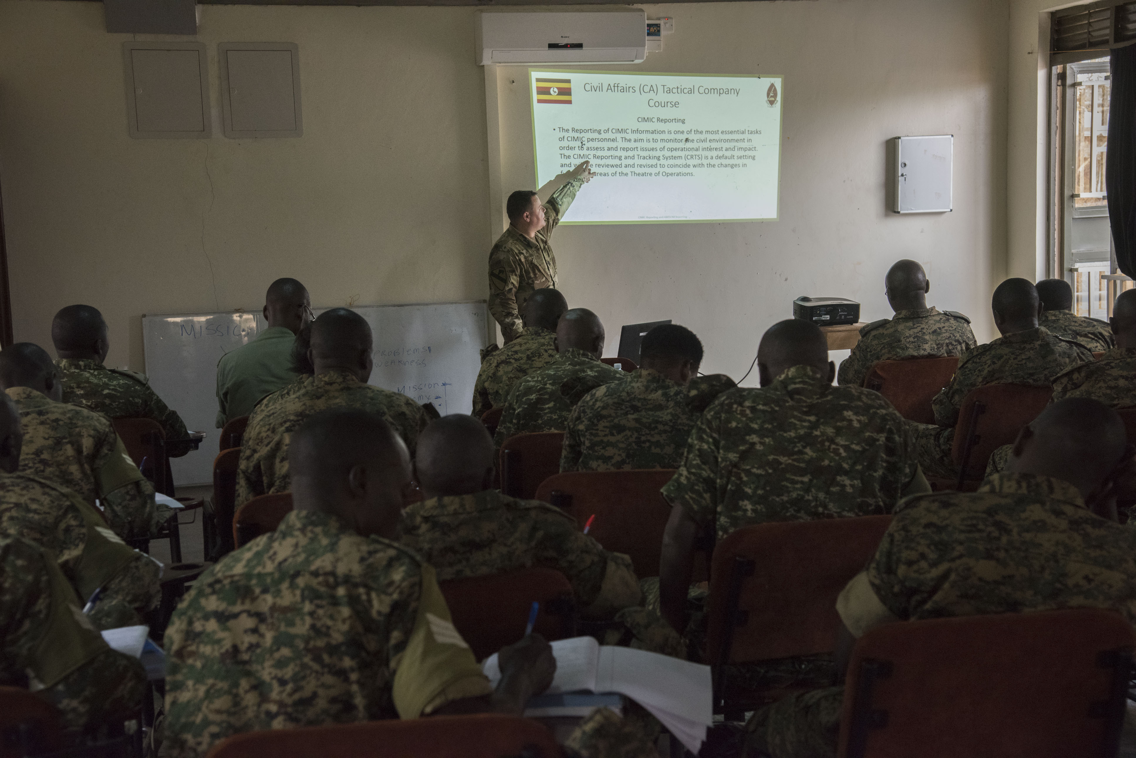 U.S. Army Capt. Raphael Howard III, assigned to the 407th Civil Affairs (CA) Battalion, attached to the Combined Joint Task Force - Horn of Africa, teaches a Civil-Military (CIMIC) reporting class to soldiers from the Uganda People's Defence Force (UPDF) as part of a Civil Affairs Tactical Company Course held at Camp Singo, Uganda, Feb. 08, 2018.  CJTF-HOA service members are forward deployed to Camp Singo to advise and assist the UPDF in preparing Ugandan Battle Group 25 for an upcoming deployment in support of the African Union Mission in Somalia (AMISOM). (U.S. Air National Guard photo by Staff Sgt. Allyson L. Manners)