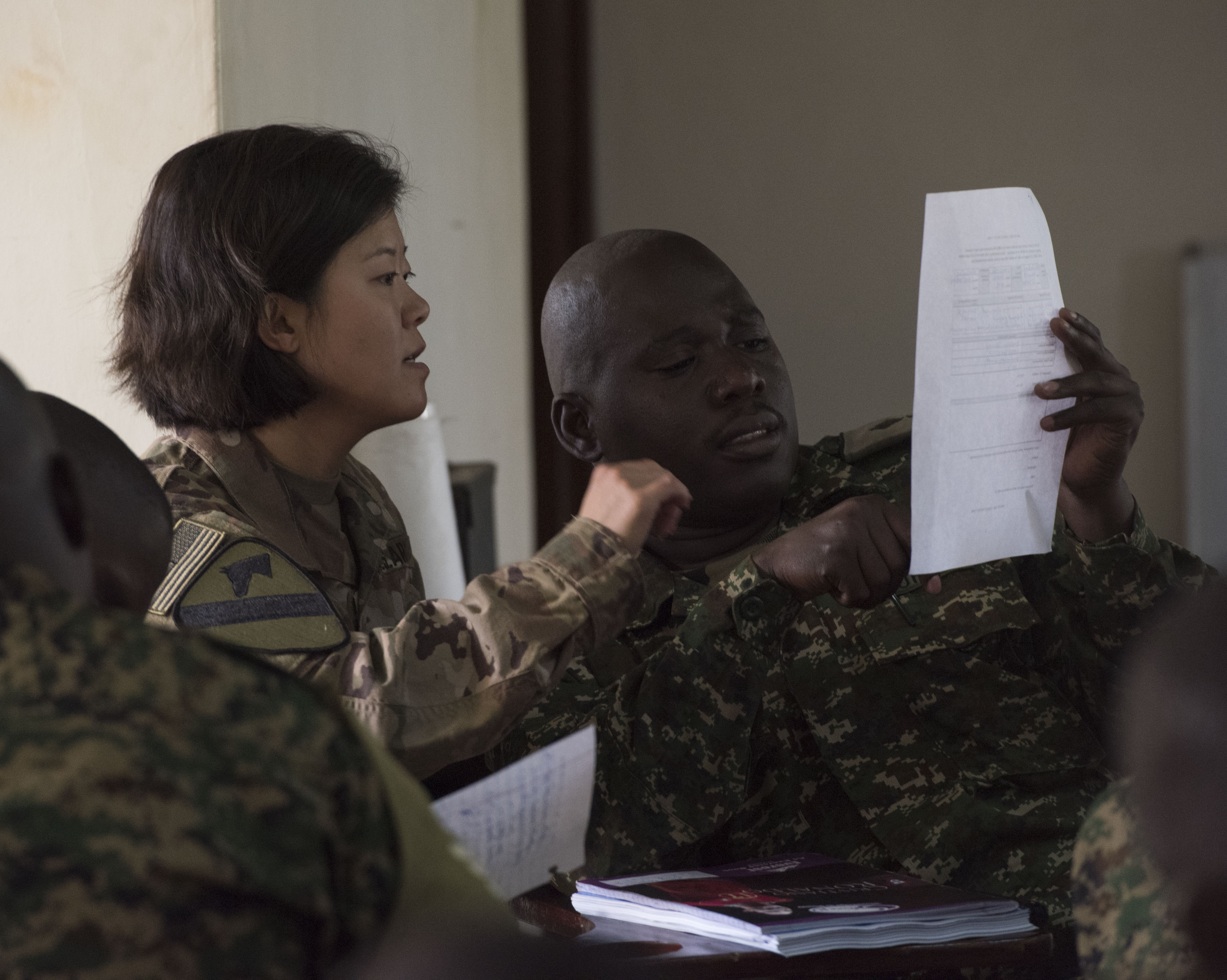 U.S. Army Sgt. 1st Class Bethany Bedard, assigned to the 407th Civil Affairs (CA) Battalion, attached to the Combined Joint Task Force - Horn of Africa, teaches a Civil-Military (CIMIC) course to soldiers from the Uganda People's Defence Force (UPDF) as part of a Civil Affairs Tactical Company Course held at Camp Singo, Uganda, Feb. 08, 2018.  CJTF-HOA service members are forward deployed to Camp Singo to advise and assist the UPDF in preparing Ugandan Battle Group 25 for an upcoming deployment in support of the African Union Mission in Somalia (AMISOM). (U.S. Air National Guard photo by Staff Sgt. Allyson L. Manners)