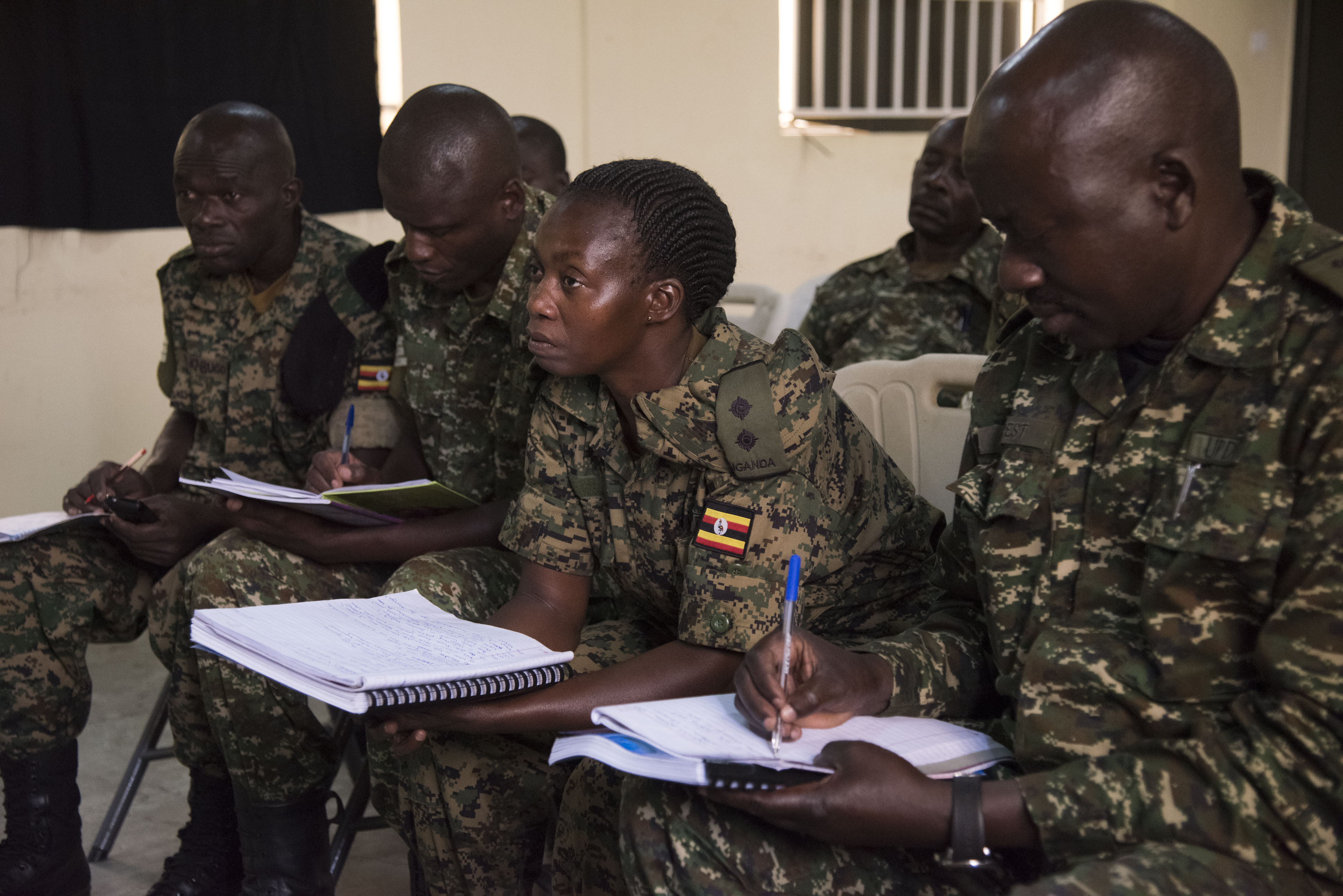 A Uganda People's Defence Force soldier leads a mock interview as part of a Civil-Military (CIMIC) course taught by U.S. Soldiers assigned to the 407th Civil Affairs (CA) Battalion, attached to the Combined Joint Task Force - Horn of Africa, Feb. 13, 2018. CJTF-HOA service members are forward deployed to Camp Singo, Uganda to advise and assist the UPDF in preparing Ugandan Battle Group 25 for an upcoming deployment in support of the African Union Mission in Somalia (AMISOM). (U.S. Air National Guard photo by Staff Sgt. Allyson L. Manners)