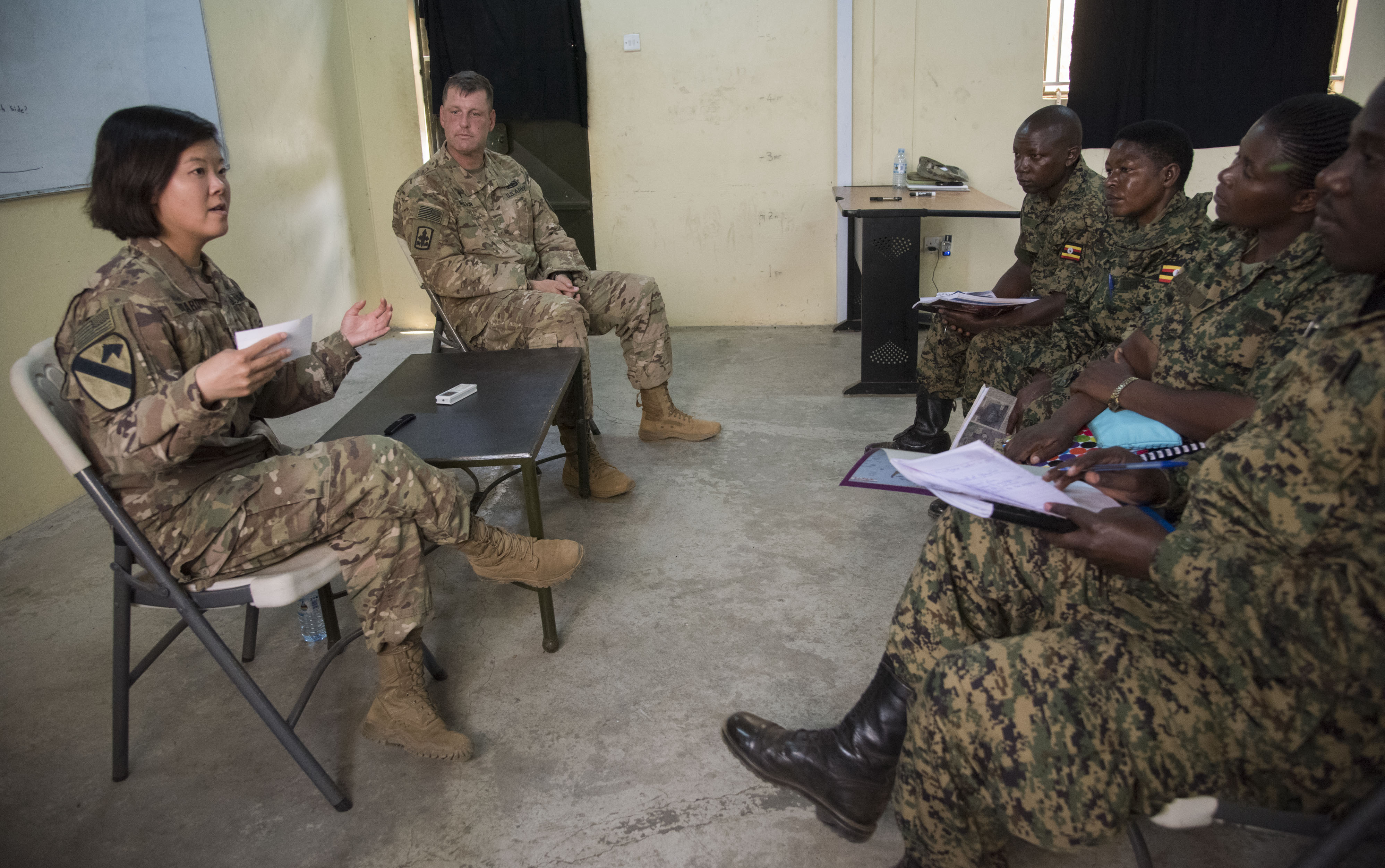 U. S. Army Sgt. 1st Class Bethany Bedard, assigned to the 407th Civil Affairs (CA) Battalion, and Chaplain (Maj.) Christopher Melvin, Religious Affairs, attached to the Combined Joint Task Force - Horn of Africa, conduct a mock Civil-Military (CIMIC)  interview with soldiers from the Uganda People's Defence Force (UPDF) as part of a Civil Affairs Tactical Company Course held at Camp Singo, Uganda, Feb. 08, 2018.  CJTF-HOA service members are forward deployed to Camp Singo to advise and assist the UPDF in preparing Ugandan Battle Group 25 for an upcoming deployment in support of the African Union Mission in Somalia (AMISOM). (U.S. Air National Guard photo by Staff Sgt. Allyson L. Manners)