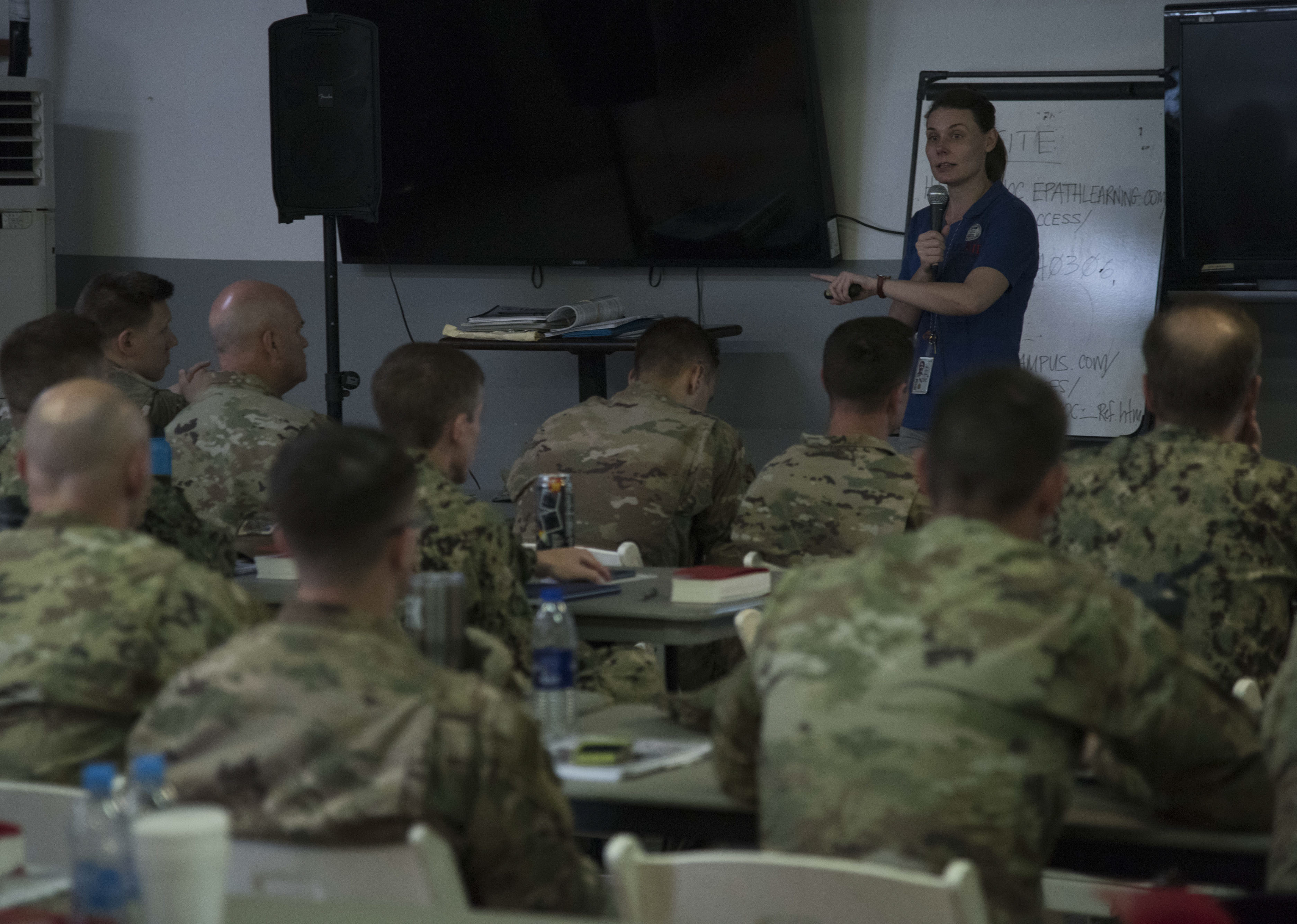 Leigh Caraher, an instructor from the U.S. Agency for International Development's Office of Foreign Disaster Assistance, teaches a Joint Humanitarian Operations Course to service members deployed to Camp Lemonnier, Djibouti, March 7, 2018. Members attended the two-day course, which highlighted international disaster response, best practices and the U.S. military's role when supporting foreign humanitarian assistance and disaster relief operations. (U.S. Air National Guard photo by Staff Sgt. Allyson L. Manners)