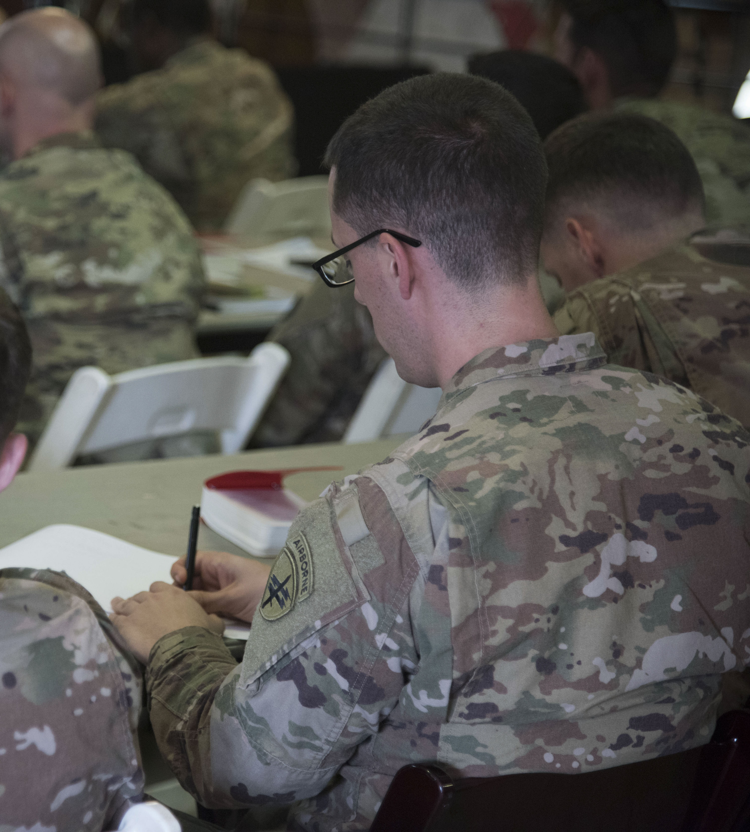 U.S. Army Capt. Brendan Quinn, with the 404th Civil Affairs Battalion, attached to the Combined Joint Task Force - Horn of Africa, takes notes during a U.S. Agency for International Development's Joint Humanitarian Operations Course at Camp Lemonnier, Djibouti, March 7, 2018. Members attended the two-day course, which highlighted international disaster response, best practices and the U.S. military's role when supporting foreign humanitarian assistance and disaster relief operations. (U.S. Air National Guard photo by Staff Sgt. Allyson L. Manners)
