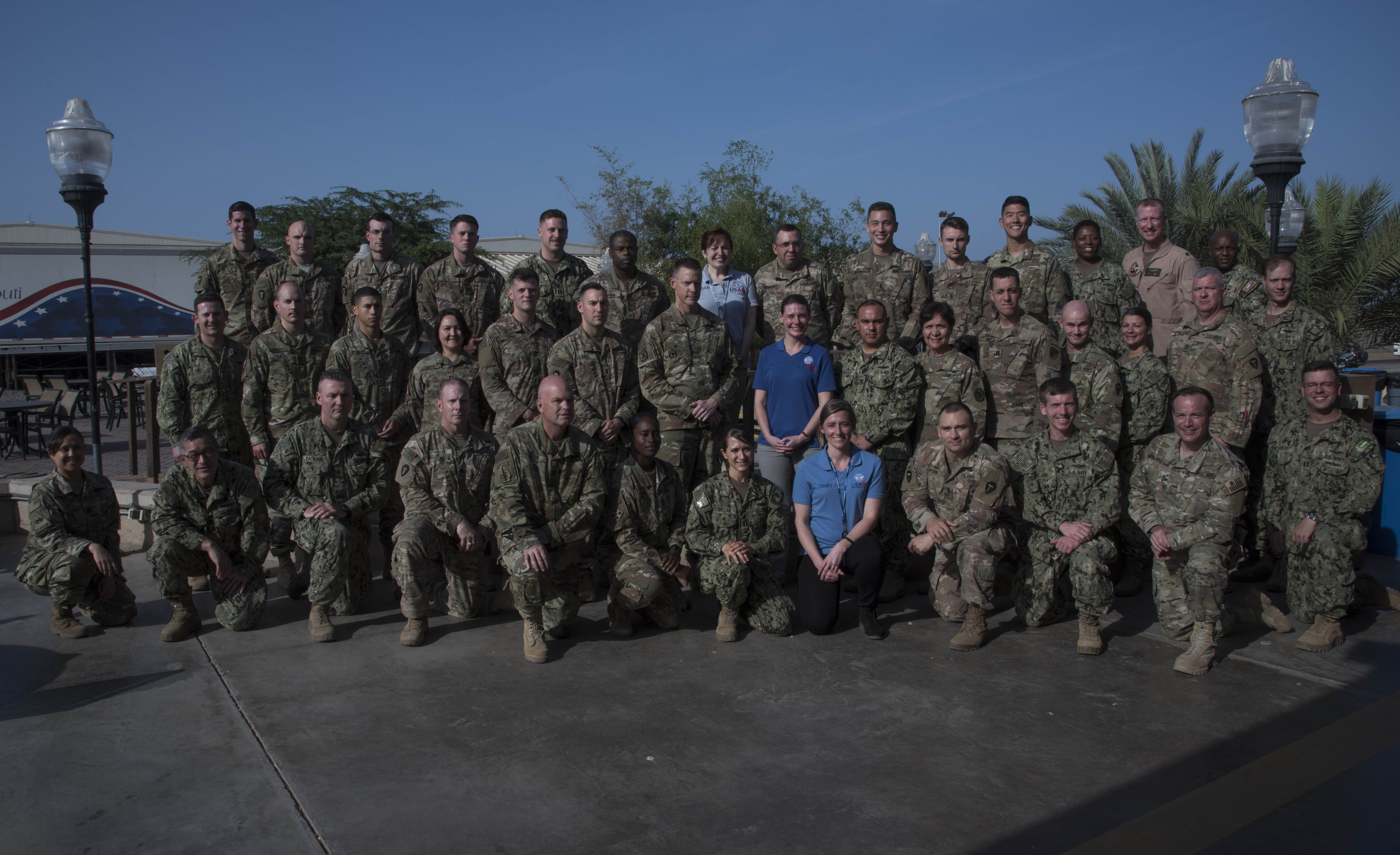 Service members deployed to Camp Lemonnier, Djibouti, pose for a class photo with instructors from the U.S. Agency for International Development (USAID) at Camp Lemonnier, Djibouti, March 7, 2018. Members attended the two-day USAID Joint Humanitarian Operations Course, which highlighted international disaster response, best practices and the U.S. military's role when supporting foreign humanitarian assistance and disaster relief operations. (U.S. Air National Guard photo by Staff Sgt. Allyson L. Manners)