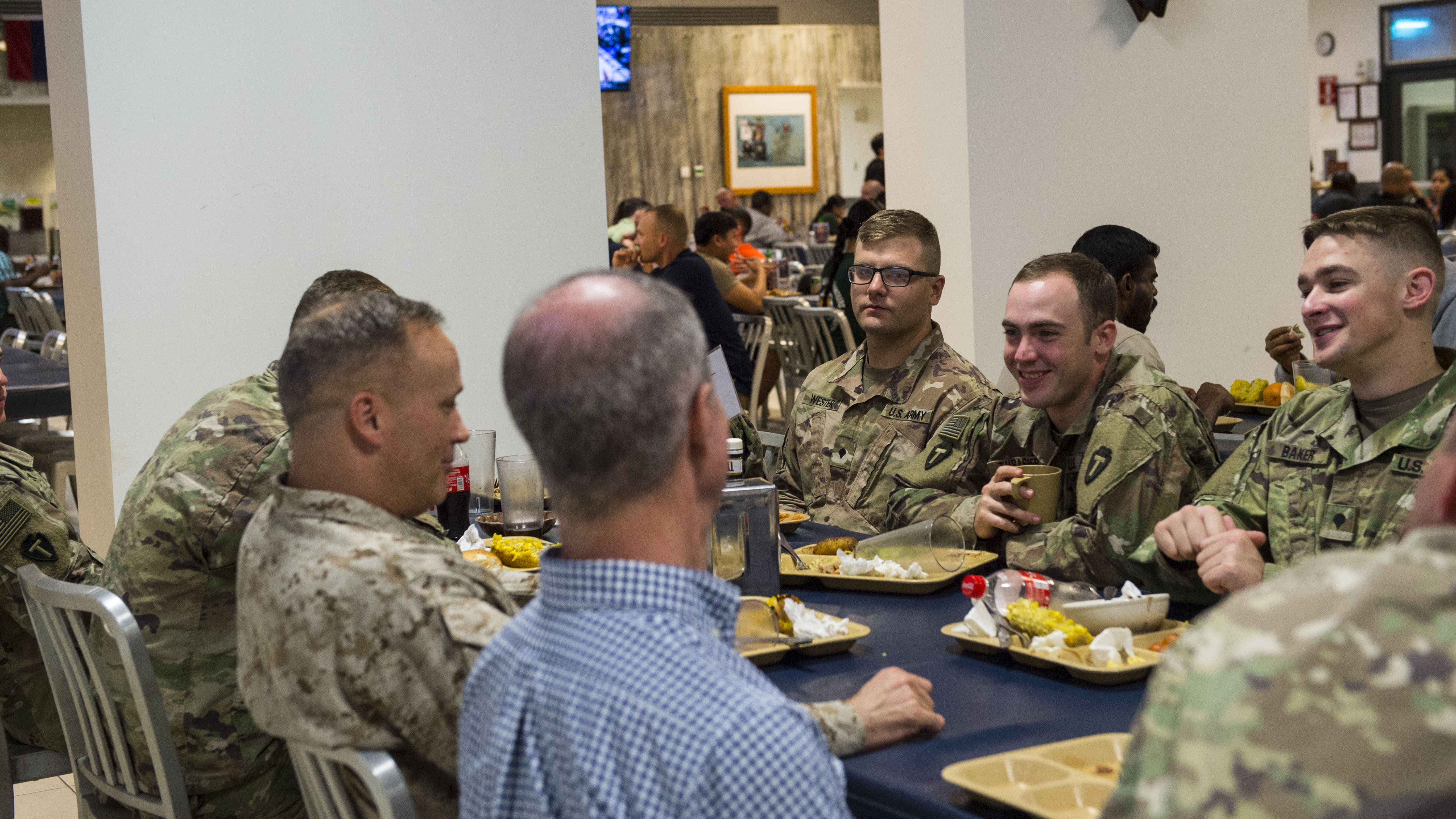 U.S. Rep. Mac Thornberry, 13th District of Texas, has dinner with U.S. Marine Corps Maj. Gen. David Furness, Commanding General of the Combined Joint Task Force - Horn of Africa (CJTF-HOA), and other service members deployed to Camp Lemonnier, Djibouti, during a visit to the CJTF-HOA March 24, 2018. Thornberry, who is the U.S. House of Representatives Armed Services Committee Chairman, stopped by Camp Lemonnier before visiting other locations within the CJTF-HOA area of responsibility. The Armed Services Committee has the responsibility to oversee the Pentagon, all military services, and all Department of Defense agencies, including their budgets and policies. (U.S. Air Force photo by Staff Sgt. Timothy Moore)