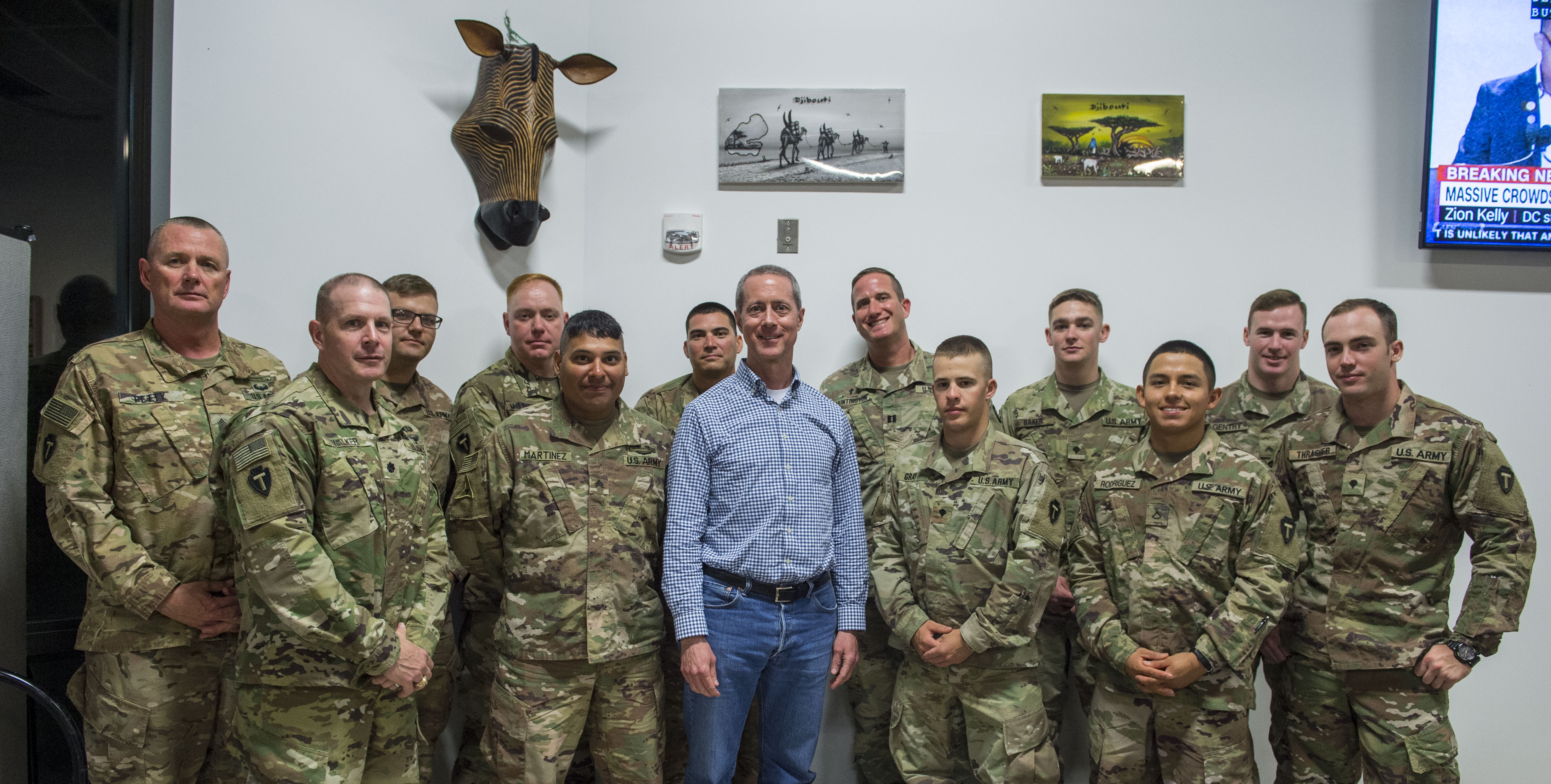 U.S. Rep. Mac Thornberry, 13th District of Texas, poses for a photo with service members deployed to Camp Lemonnier, Djibouti, during a visit to the Combined Joint Task Force - Horn of Africa (CJTF-HOA) March 24, 2018. Thornberry, who is the U.S. House of Representatives Armed Services Committee Chairman, stopped by Camp Lemonnier before visiting other locations within the CJTF-HOA area of responsibility. The Armed Services Committee has the responsibility to oversee the Pentagon, all military services, and all Department of Defense agencies, including their budgets and policies. (U.S. Air Force photo by Staff Sgt. Timothy Moore)