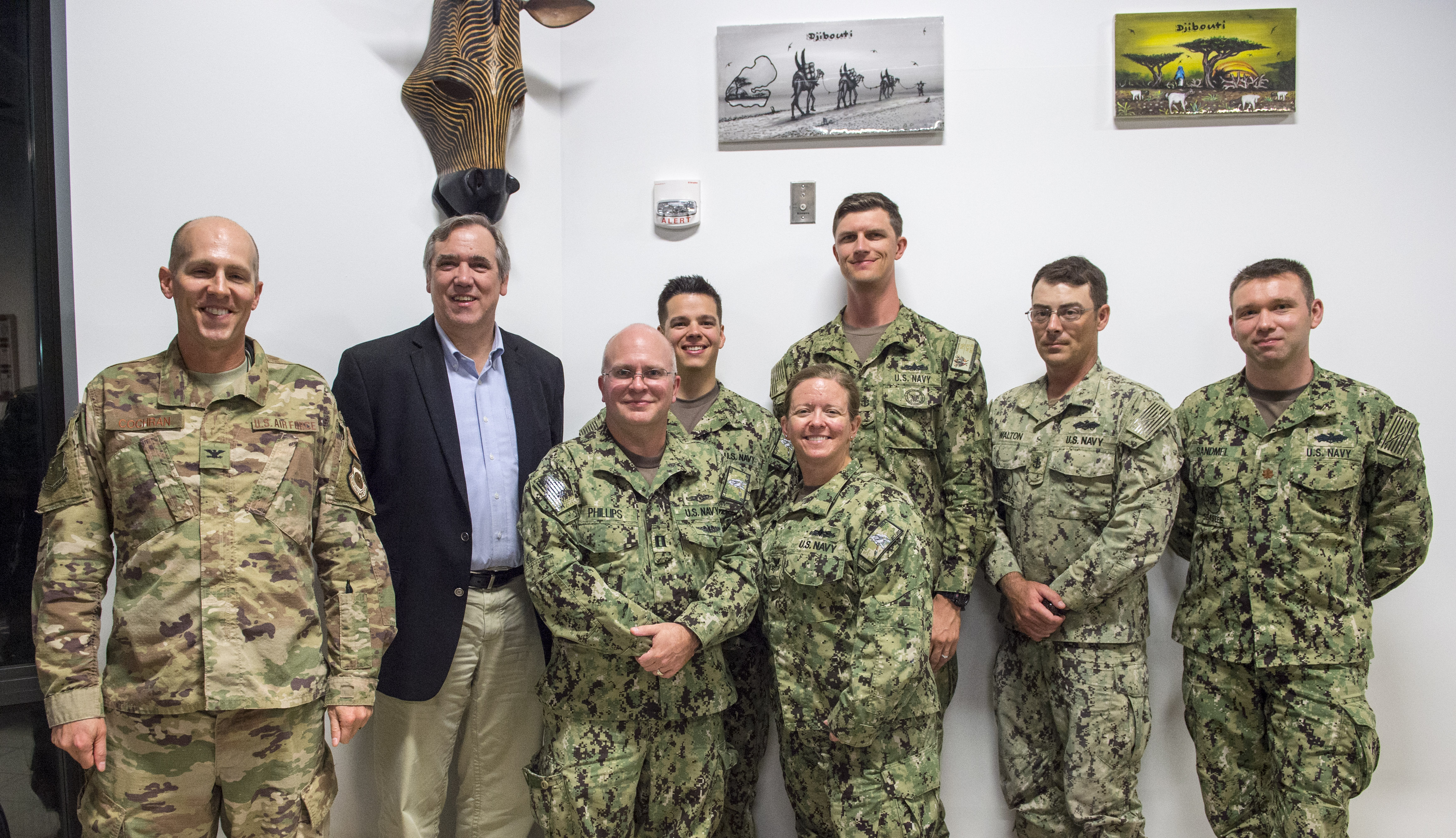 U.S. Sen. Jeff Merkley, Oregon, poses for a photo with service members deployed to Camp Lemonnier, Djibouti, during a visit to the Combined Joint Task Force - Horn of Africa (CJTF-HOA) March 26, 2018. Merkley visited with service members at Camp Lemonnier before continuing his trip to other locations in East Africa. As a member of the U.S. Senate Foreign Relations Committee, Merkley's visit focused on the critical role that U.S. assistance plays as he examined famine-like conditions, severe food shortages, internally displaced persons and refugees in each location and how these factors affect counter-terrorism efforts within the CTJF-HOA area of responsibility. (U.S. Air Force photo by Staff Sgt. Timothy Moore)