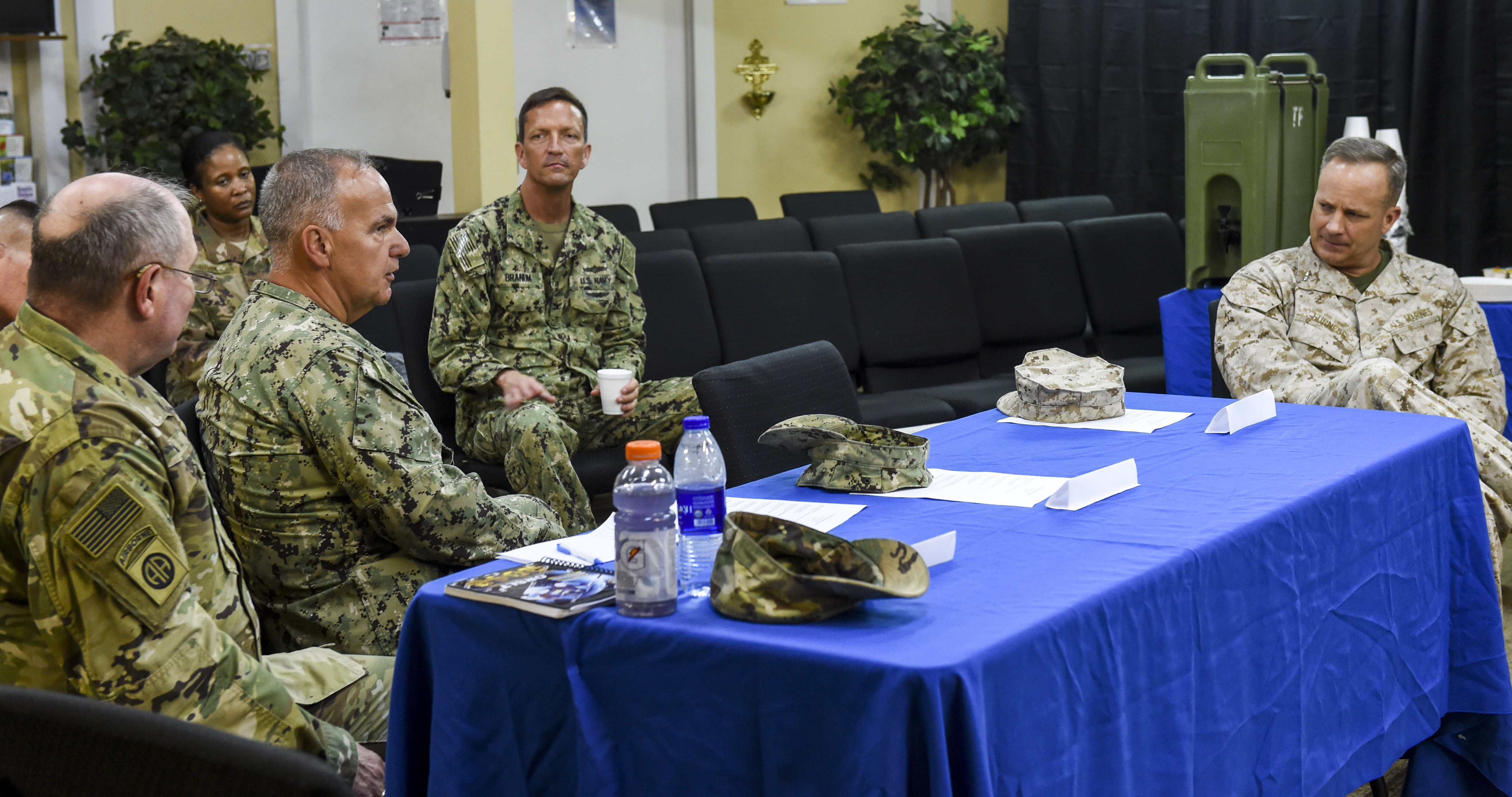 Chaplains and chaplain assistants from U.S. Africa Command (AFRICOM), U.S. Army Africa (USARAF), and U.S. Air Forces Africa (AFAFRICA) listen to U.S. Marine Corps Maj. Gen. David Furness, commanding general of Combined Joint Task Force-Horn of Africa (CJTF-HOA), during a religious affairs workshop at Camp Lemonnier, Djibouti, April 11, 2018. The CJTF-HOA Religious Affairs team hosted the workshop to synchronize and plan the support they provide for service members throughout the combined joint operating area. (U.S. Air Force photo by Staff Sgt. Timothy Moore)