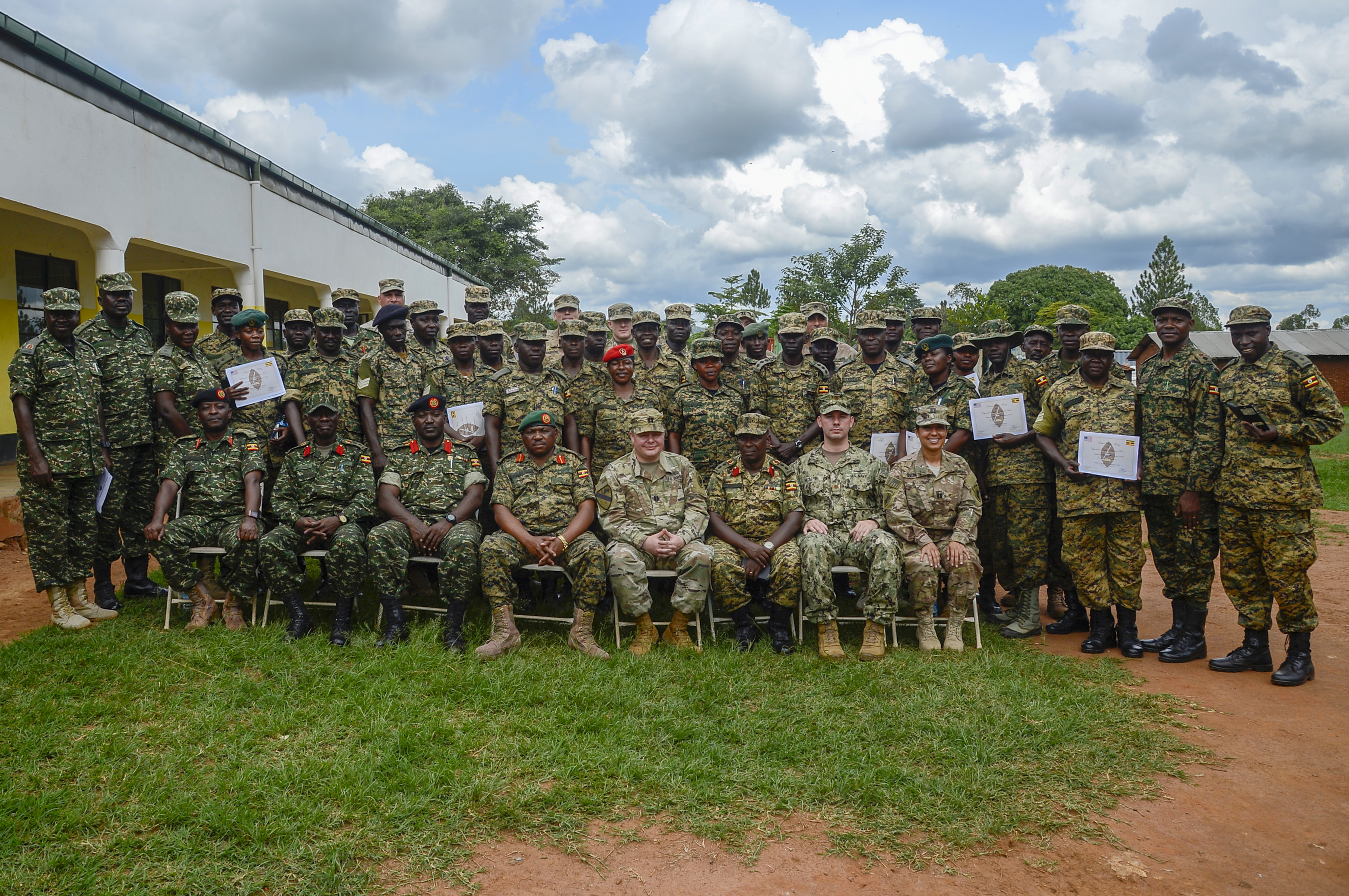 Uganda People's Defense Force (UPDF) Soldiers and U.S. Army Soldiers from the 404th Civil Affairs Battalion, attached to the Combined Joint Task Force - Horn of Africa, pose for a group photo after a graduation ceremony from a 10-week civil affairs operations course provided by members of the 404th at Camp Singo, Uganda, April 13, 2018. The civil affairs course is designed to enhance the UPDF's capability and capacity to support its enduring African Union peacekeeping force and African Union Mission in Somalia mandates through civil military cooperation. (U.S. Navy Photo by Mass Communication Specialist 2nd Class Timothy M. Ahearn)