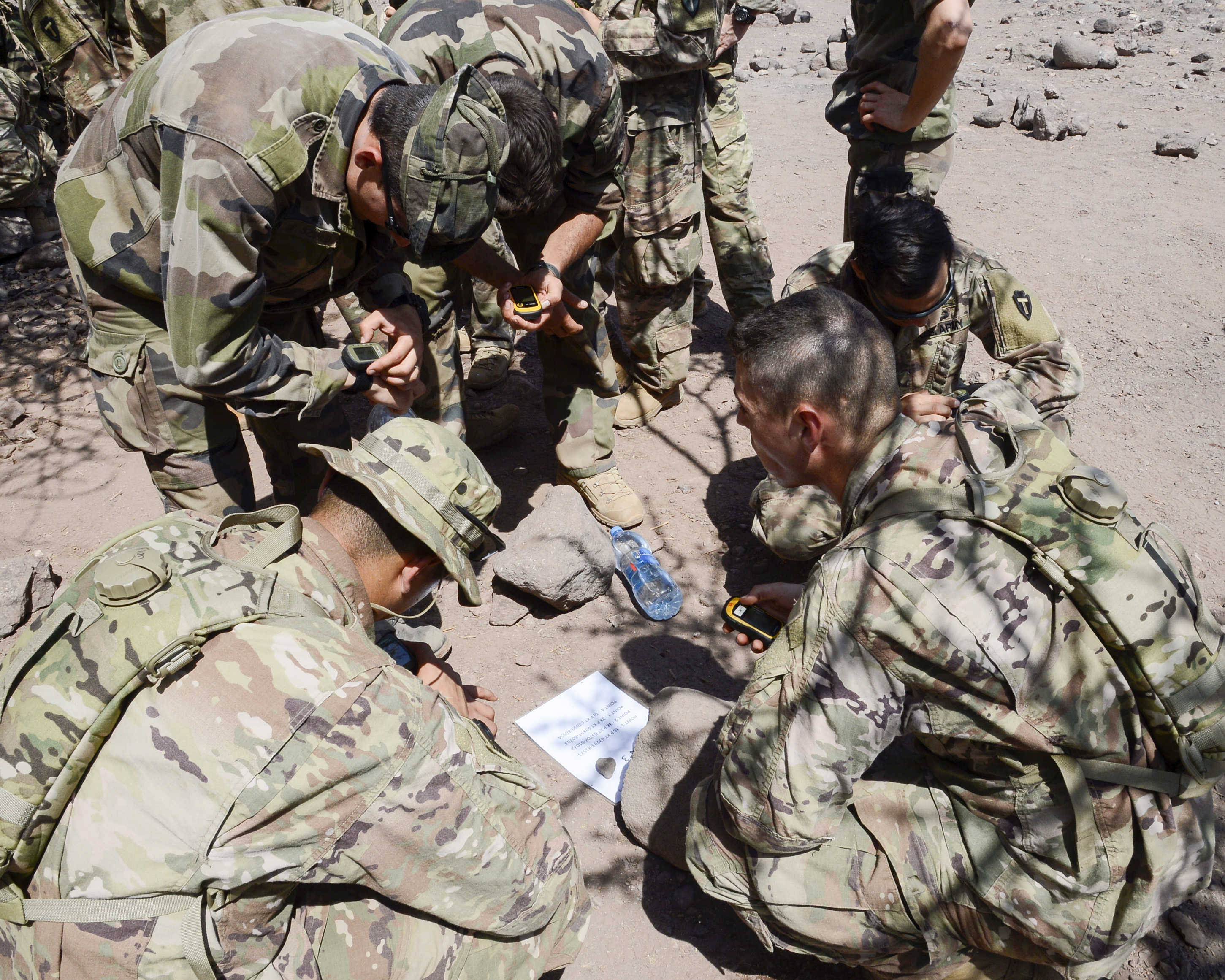U.S. Army Soldiers alongside French soldiers, deployed to Combined Joint Task Force-Horn of Africa, prepare to start desert land navigation during the French Desert Commando Course at the Centre Dentrainment Au Combat Djibouti in Arta Plage, Djibouti, April 21, 2018.  The four-day phase is the first of two necessary to earn a coveted French Desert Commando Badge. (U.S. Navy Photo by Mass Communication Specialist 2nd Class Timothy M. Ahearn)