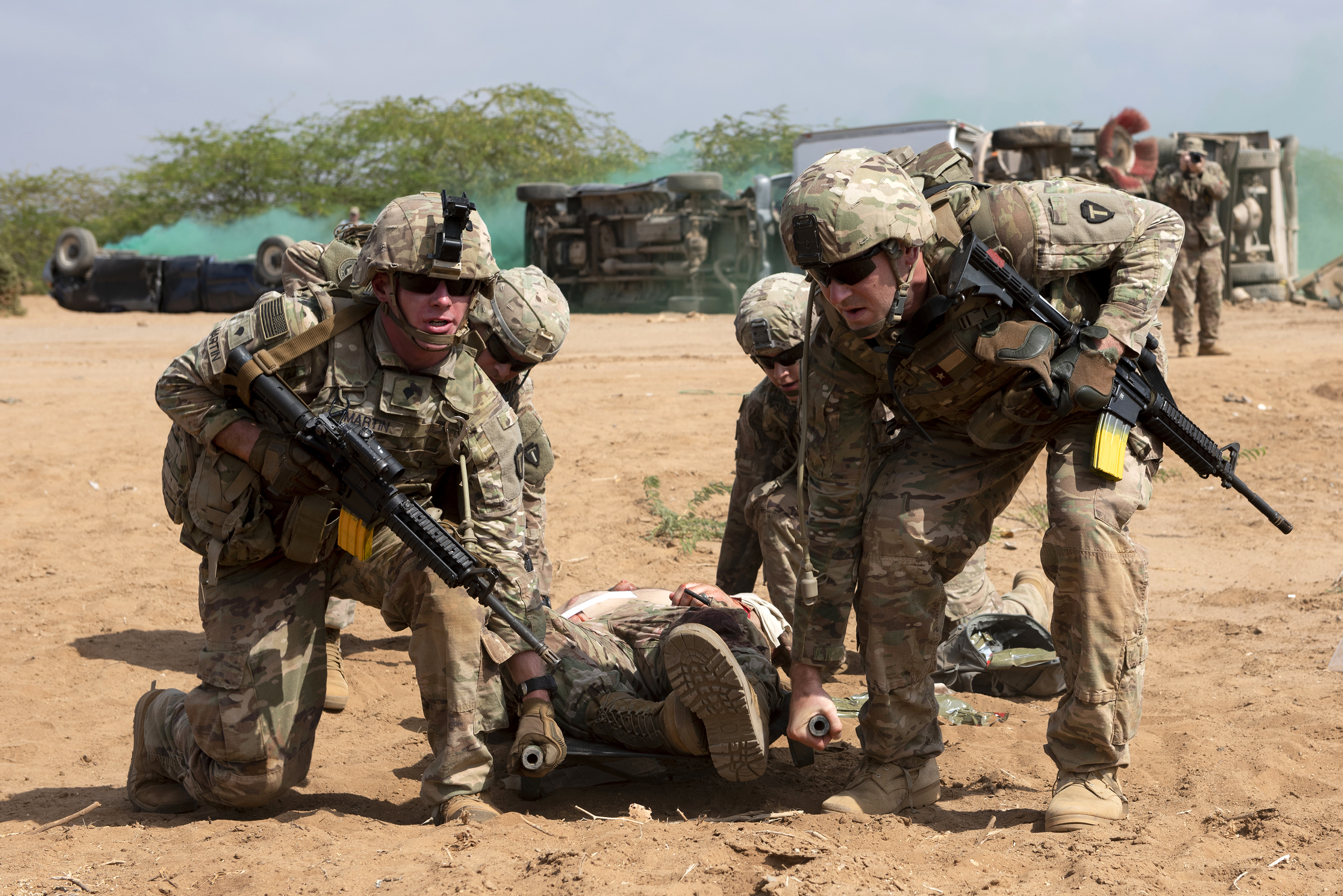 U.S. Soldiers assigned to 3rd Battalion, 144th Infantry Regiment, Texas Army National Guard, prepare to transport a simulated casualty on a litter in Djibouti City, Djibouti, April 24, 2018. As part of a joint mass casualty training exercise, service members performed various tasks in order to locate, secure and rescue simulated casualties. (U.S. Air National Guard photo by Master Sgt. Sarah Mattison)
