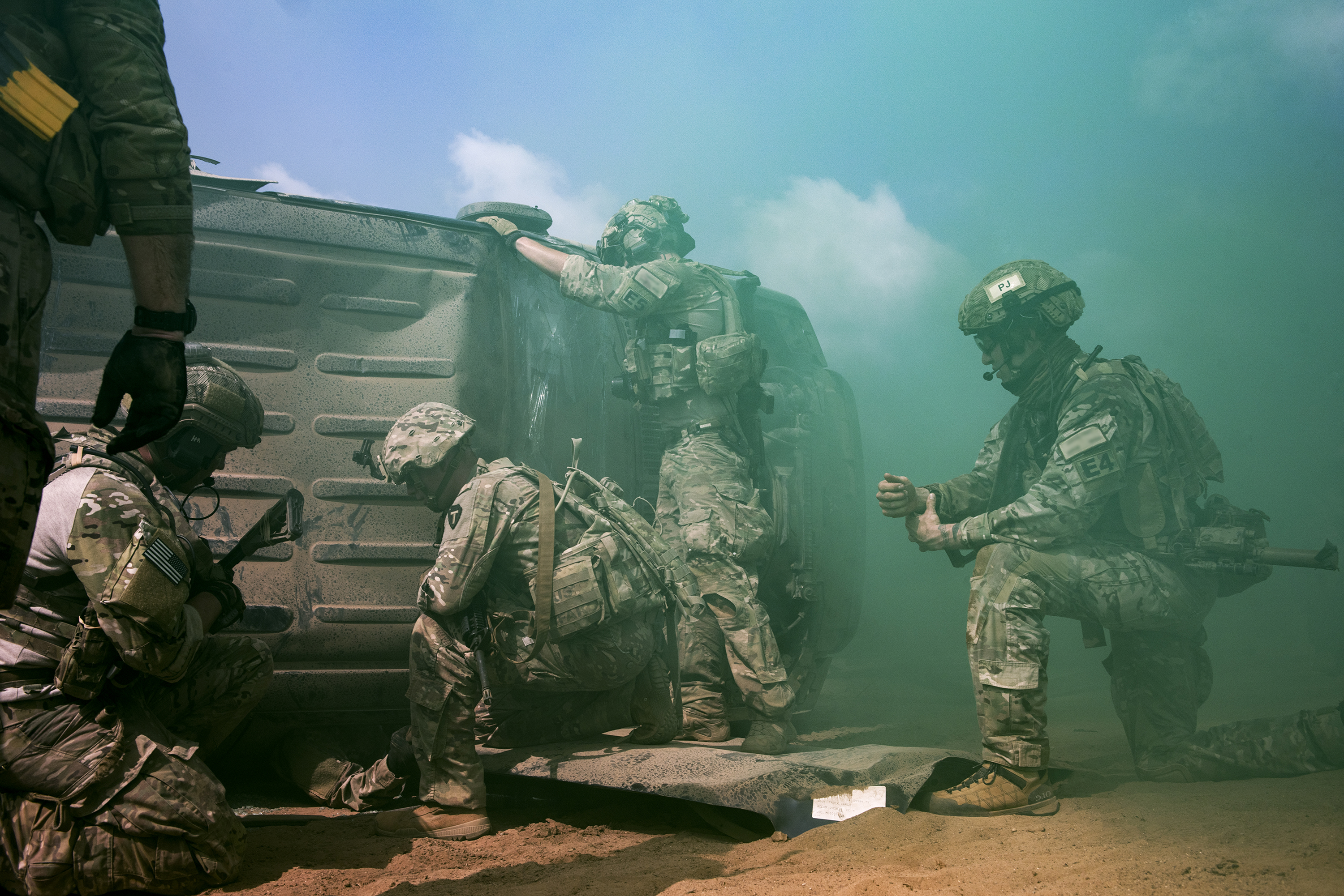 U.S. Air Force Pararescuemen from the 82nd Expeditionary Rescue Squadron and U.S. Soldiers with the Texas Army National Guard work together to rescue a simulated casualty in Djibouti City, Djibouti, April 24, 2018. As part of a joint mass casualty training exercise, service members performed various tasks in order to locate, secure and rescue simulated casualties. (U.S. Air National Guard photo by Master Sgt. Sarah Mattison) (Portions of this image were obscured for security reasons)
