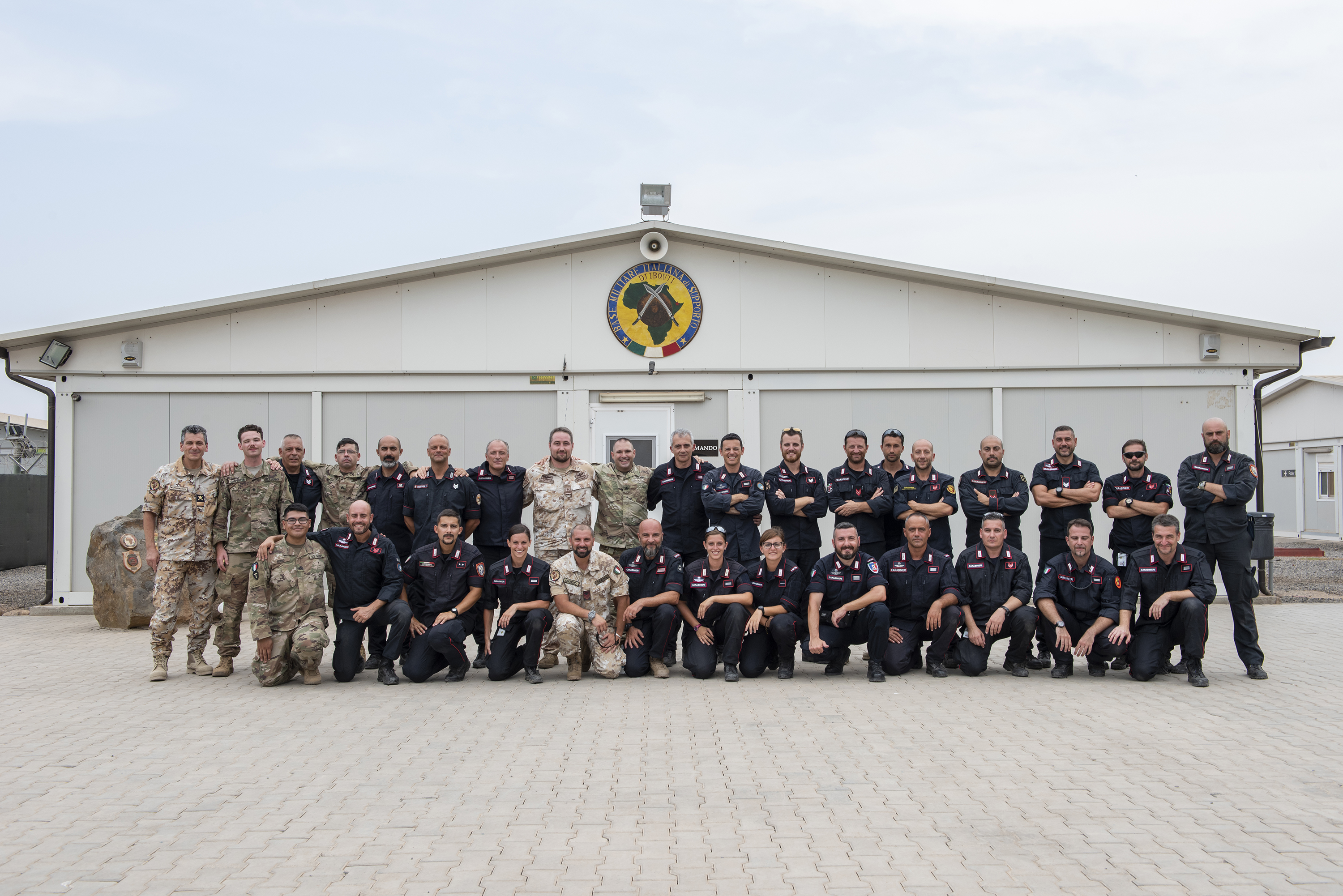 U.S. Soldiers with the 404th Civil Affairs Battalion Functional Specialty Team and the 3rd battalion, 144th Infantry Regiment, Texas Army National Guard pose for a class photo with Italian soldiers from the 1st Paratroopers Carabinieri Regiment, Tuscania, on Base Militar Italiano de Supporte, Djibouti, April 28, 2018. The soldiers taught a combat lifesaver course to 33 students over a five-day period. (U.S. Air National Guard photo by Master Sgt. Sarah Mattison)