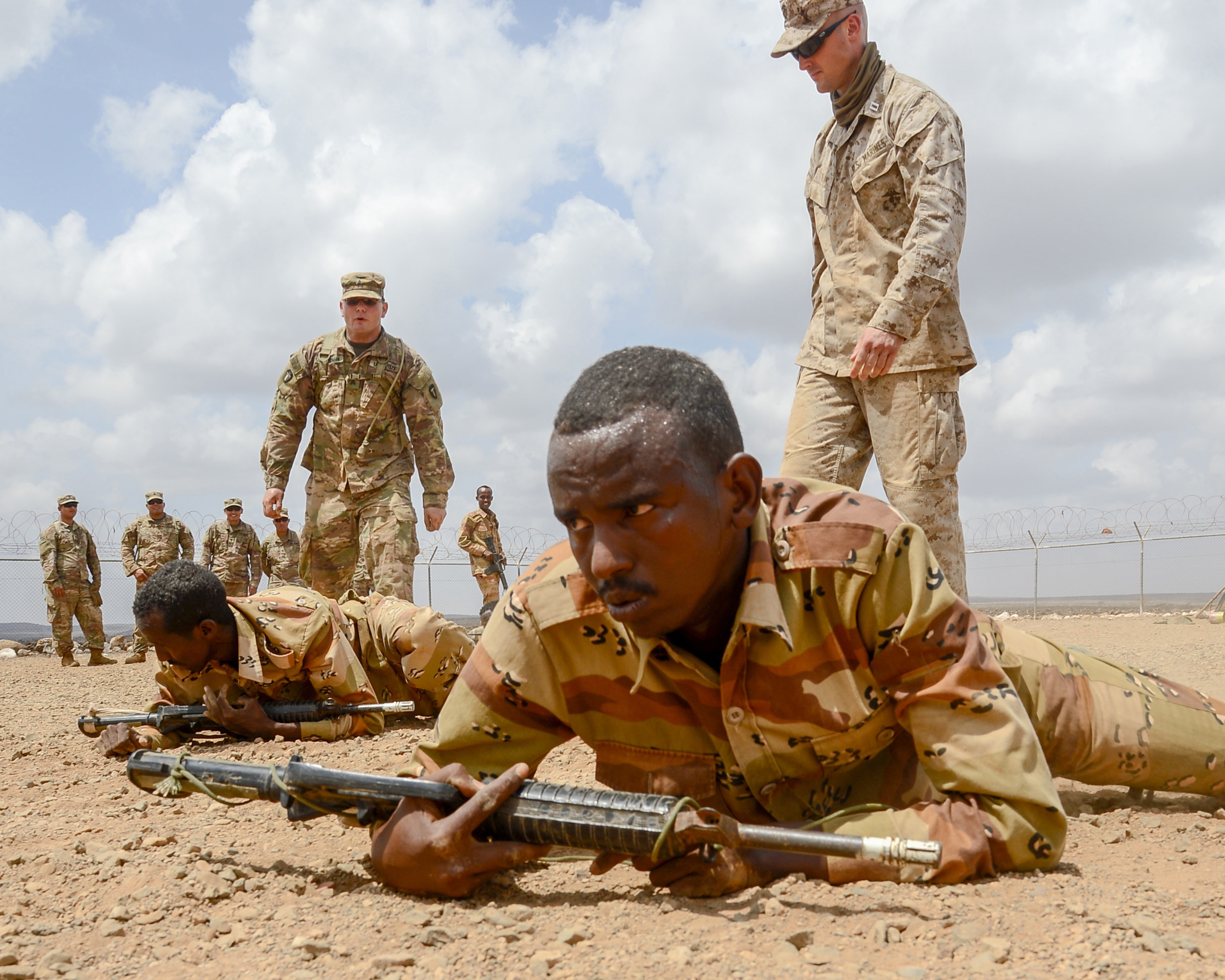U.S. Army Sergeant Vincent Merriman, Alpha Company, 3rd Battalion, 141st Infantry Regiment, Texas National Guard, monitors Djiboutian soldiers during a react-to-fire exercise at a training site outside Djibouti City, April 16, 2018. U.S. service members have been training the Djiboutian Army's Rapid Intervention Battalion, a newly formed crisis response unit. (U.S. Navy Photo by Mass Communication Specialist 2nd Class Timothy M. Ahearn)