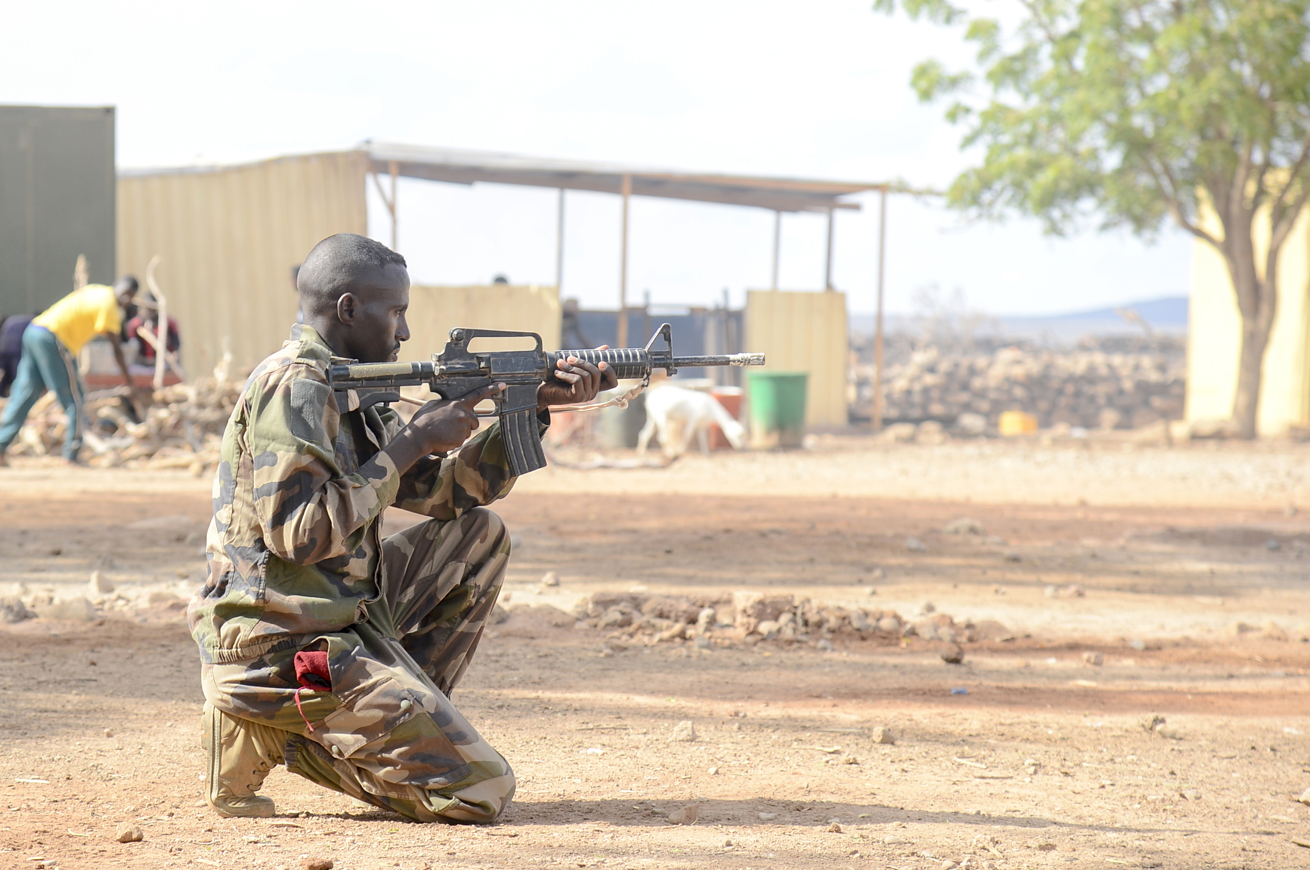 A Djiboutian soldier provides security during the culminating exercise of a five-week training cycle for the newly formed Rapid Intervention Battalion (RIB), a newly formed Djiboutian army crisis response unit, at a site outside Djibouti City, May 3, 2018.  U.S. Army Soldiers from Alpha Company, 3rd Battalion, 141st Infantry Regiment, Texas National Guard, assigned to Combined Joint Task Force- Horn of Africa conducted the RIB training. (U.S. Navy Photo by Mass Communication Specialist 2nd Class Timothy M. Ahearn)