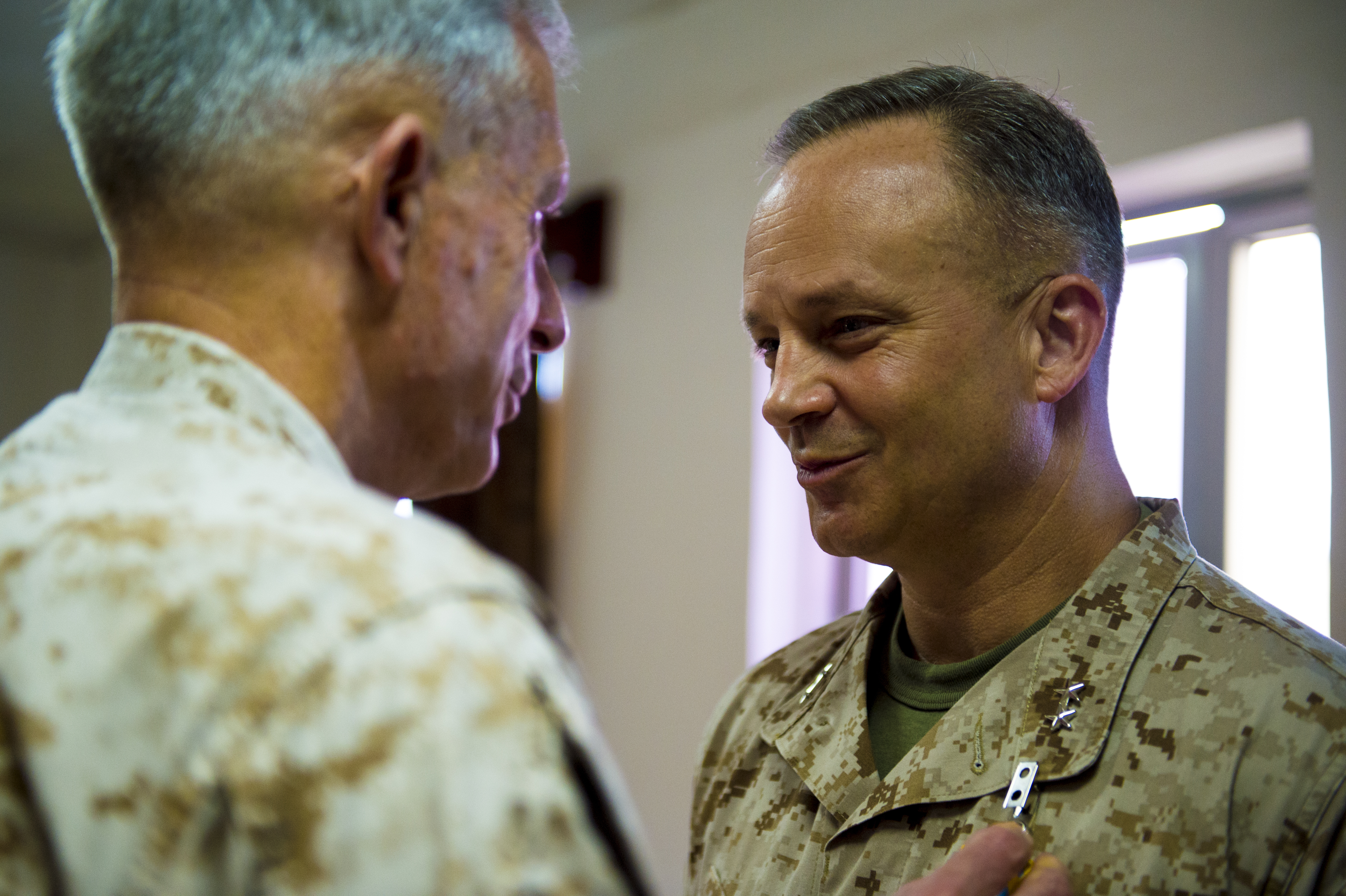 U.S. Marine Corps Gen. Thomas Waldhauser, Commander of United States Africa Command, presents Maj. Gen. David Furness, Commander of Combined Joint Task Force Horn of Africa, the defense superior service medal on Camp Lemonnier, Djibouti, May 1, 2018. Furness commanded CTJF-HOA from May 1, 2017 to May 1, 2018. (U.S. Air Force photo by Senior Airman Scott Jackson)