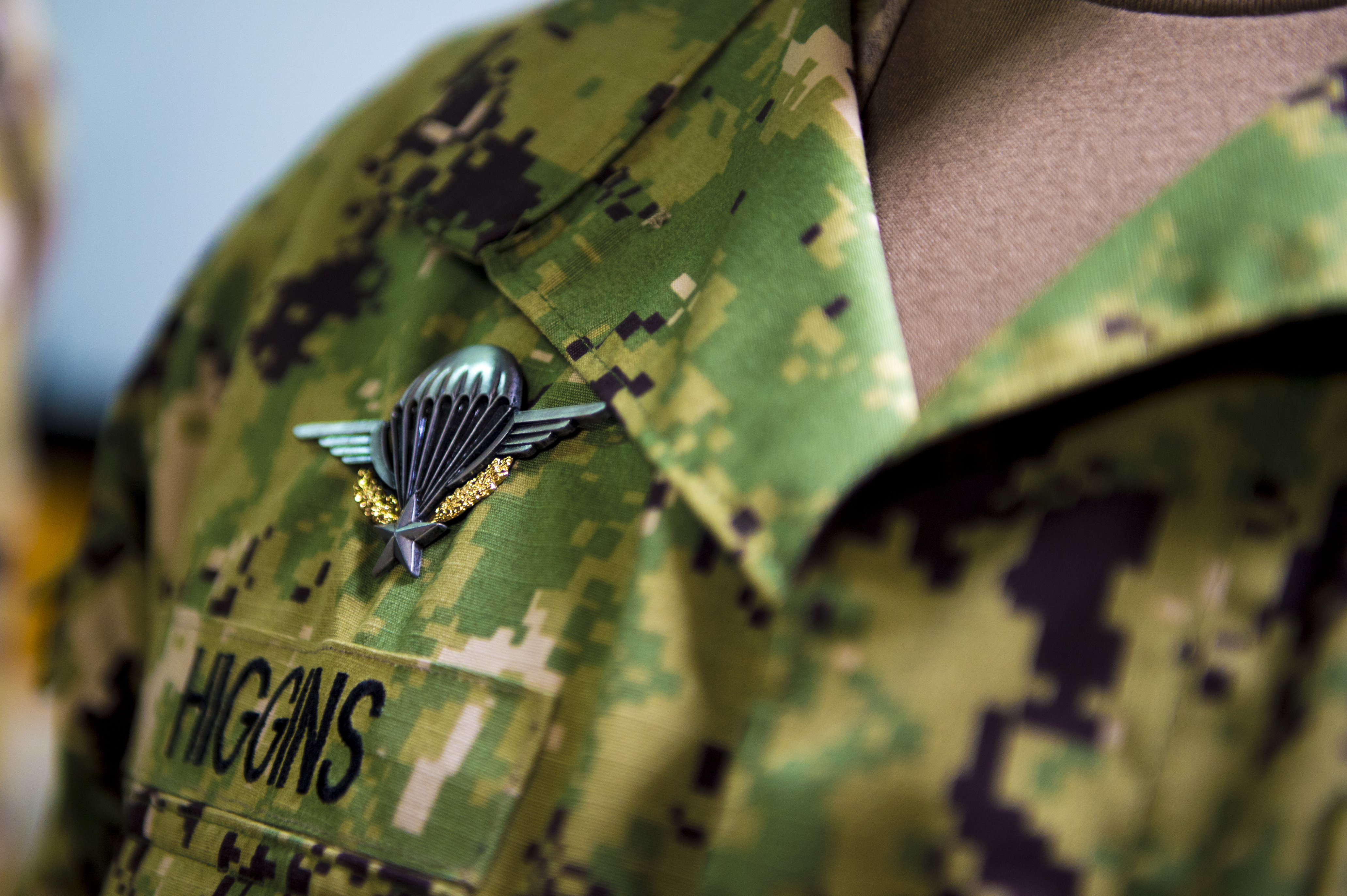 U.S. Navy Cmdr. Scott Higgins wears his French parachutist badge after jumping with the French on Camp Lemonnier, Djibouti, June 6, 2018. Both countries trained together in preparation for the jump, parachuting in remembrance and honor of our nations' friendship and alliance in World War II. (U.S. Air Force photo by Senior Airman Scott Jackson/Released)
