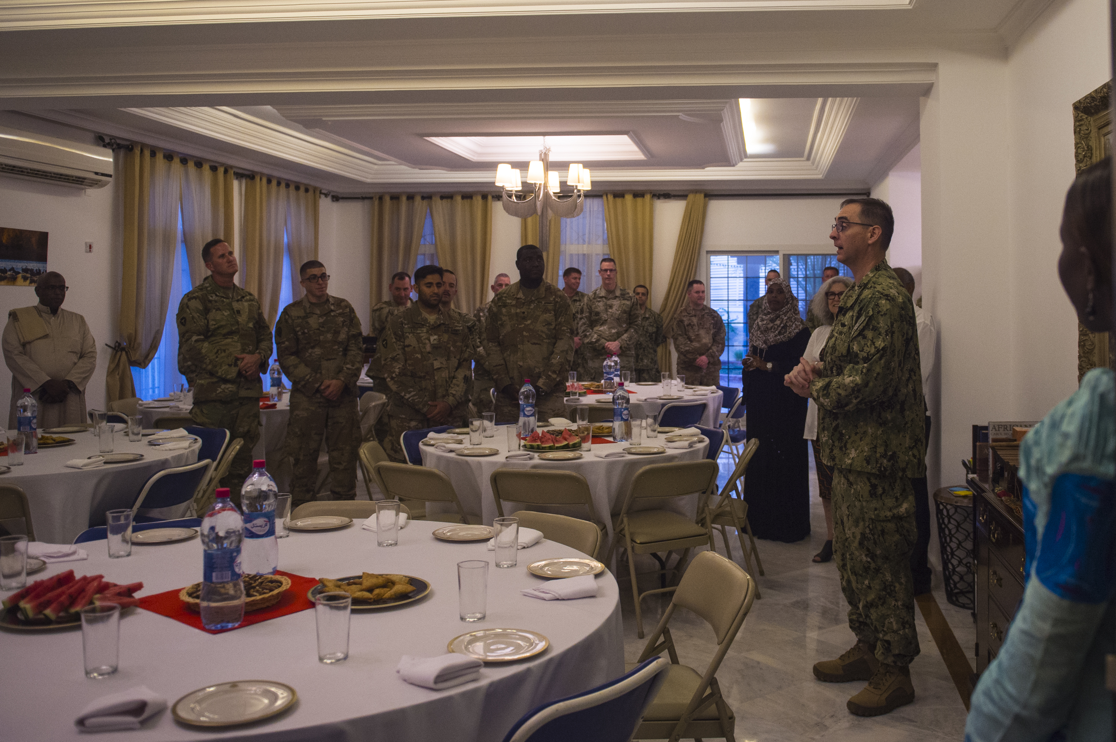 U.S. Navy Capt. John Tully, U.S. Embassy to the Republic of Djibouti Senior Defense Official and Defense Attaché, talks to visitors of the Iftar at the U.S. Ambassador to the Republic of Djibouti, Larry André's house in Djibouti, May 22, 2018. André opened his home to celebrate two Iftars, one run by the Defense Attaché Office for senior Diboutian Military and security leaders, the second for senior government, diplomatic, and business leaders.. (U.S. Air Force photo by Senior Airman Scott Jackson)
