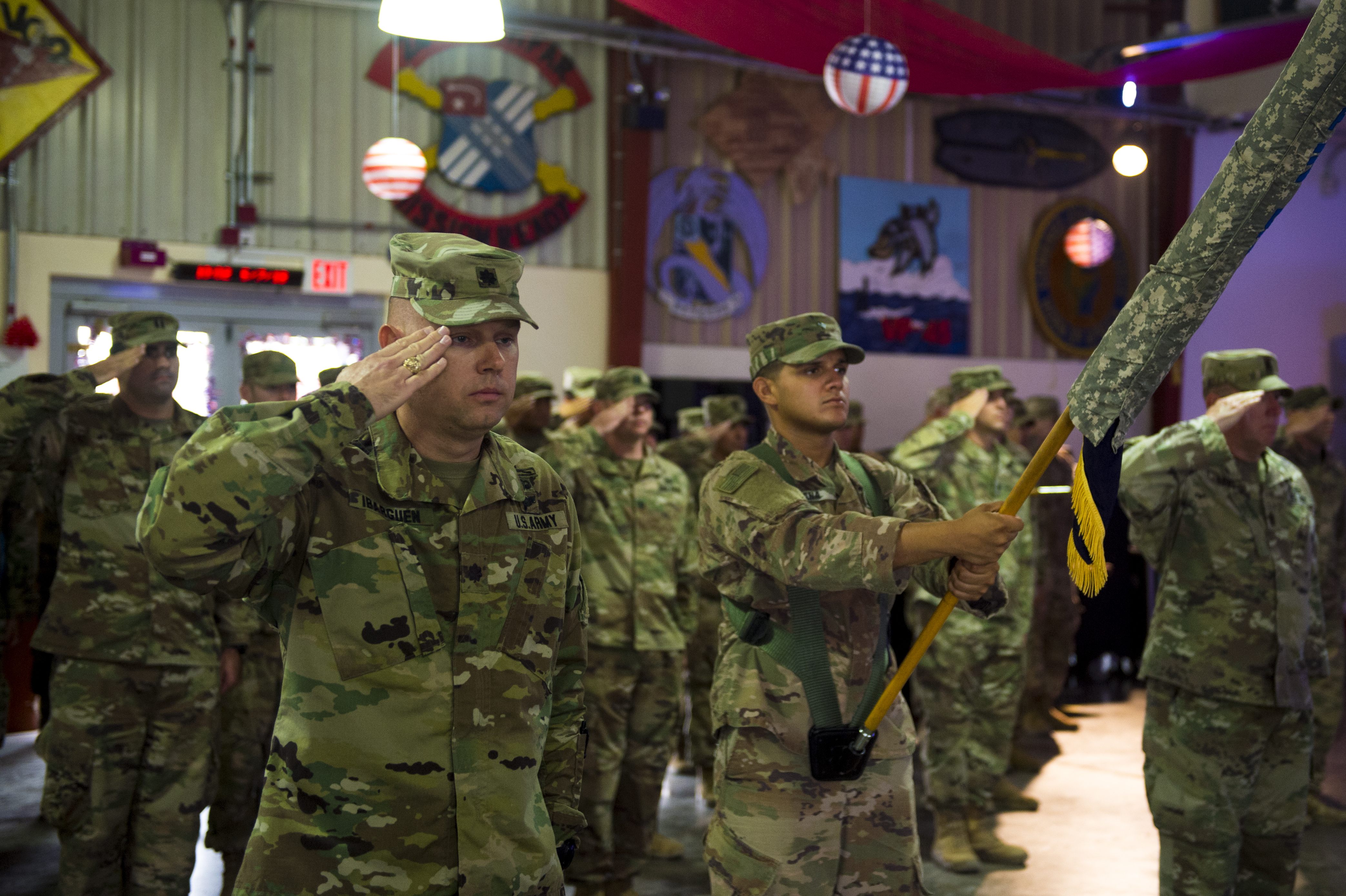 "U.S. Army Lt. Col. Sean Ibarguen, commander, 1st Battalion 141st Infantry Regiment, known as ""Task Force Alamo,"" salutes for the playing of the national anthem, during the transfer of authority ceremony on Camp Lemonnier, July 5, 2018. Task Force Alamo is taking over authority and command from Task Force Bayonet. (U.S. Air Force photo by Senior Airman Scott Jackson)"