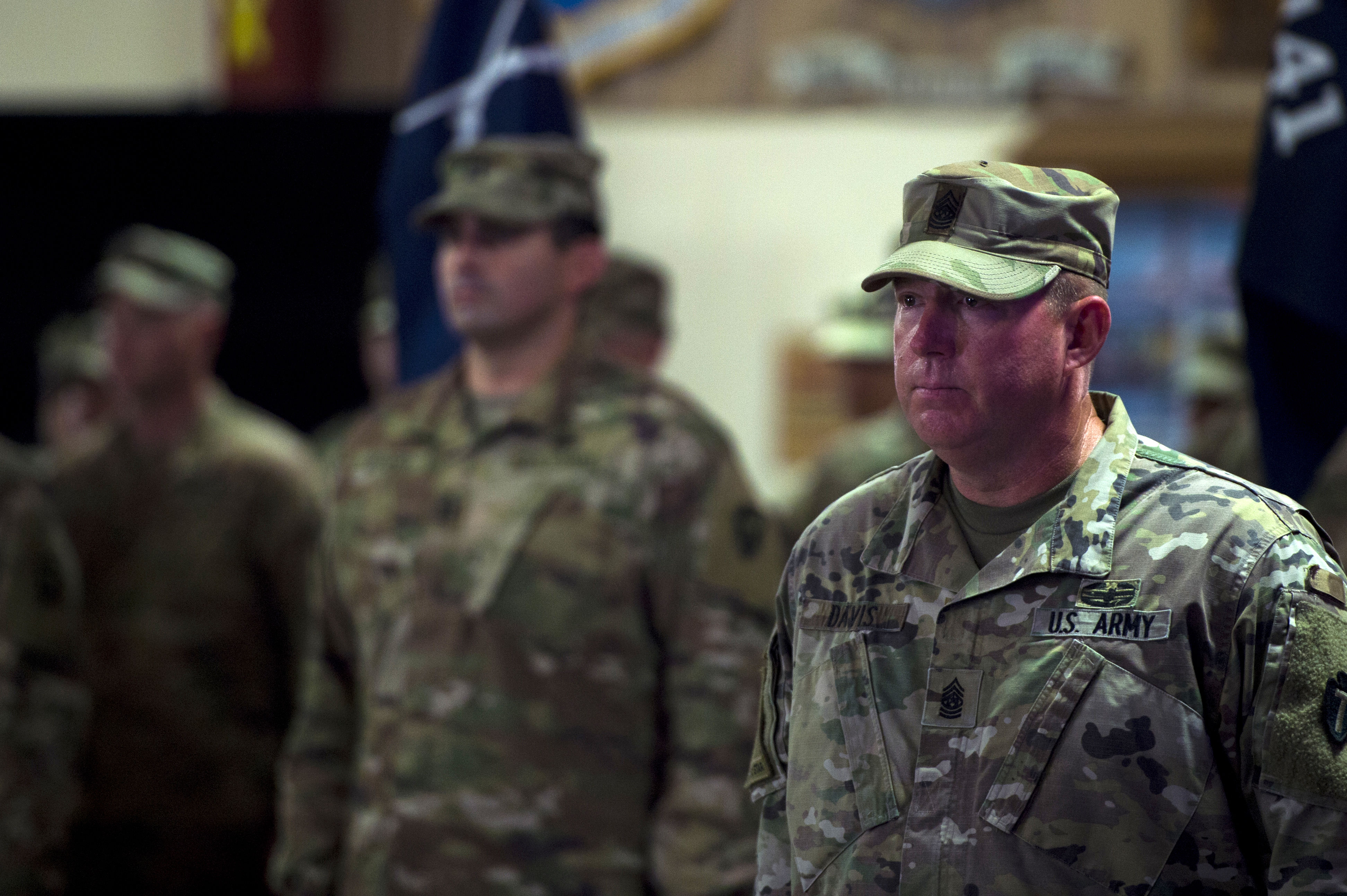 "U.S. Army Sgt. Maj Carl Davis, command sergeant major, 1st Battalion 141st Infantry Regiment, known as ""Task Force Alamo,"" stands at attention for the playing of the Army song during the transfer of authority ceremony on Camp Lemonnier, July 5, 2018. Task Force Alamo is taking over authority and command from Task Force Bayonet. (U.S. Air Force photo by Senior Airman Scott Jackson)"