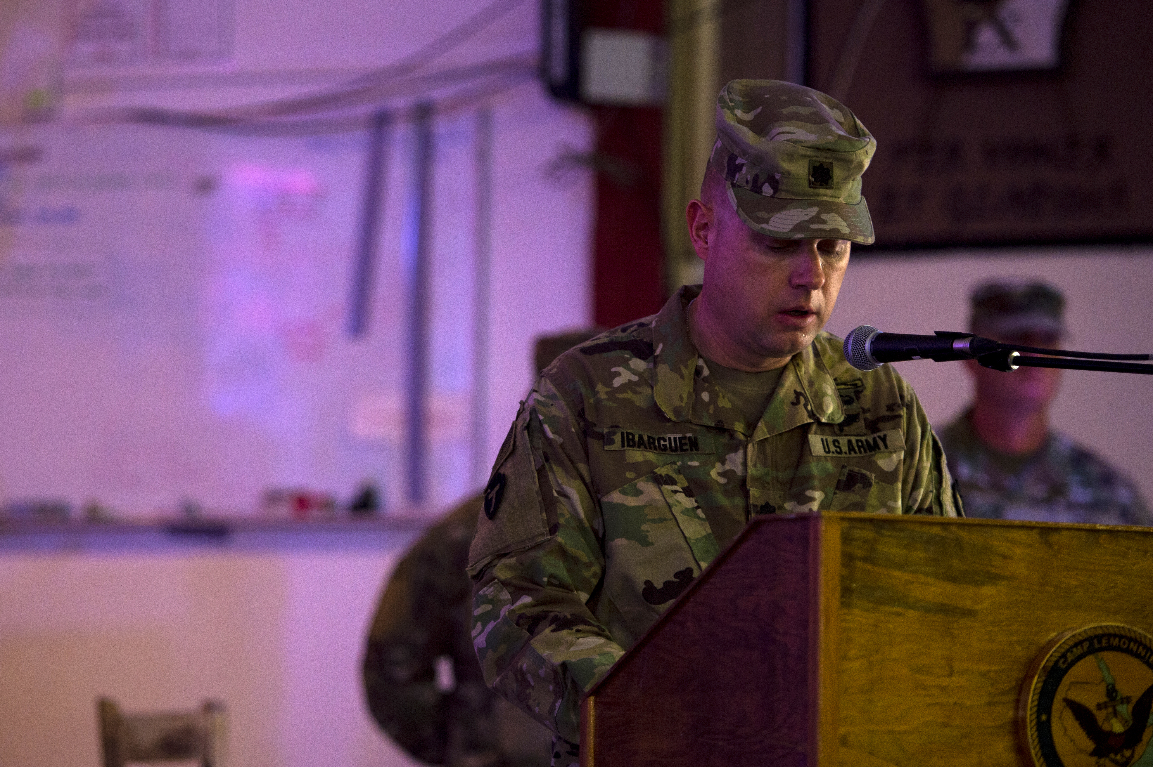 "U.S. Army Lt. Col. Sean Ibarguen, commander, 1st Battalion 141st Infantry Regiment, known as ""Task Force Alamo,"" speaks during the transfer of authority ceremony on Camp Lemonnier, July 5, 2018. Task Force Alamo is taking over authority and command from Task Force Bayonet. (U.S. Air Force photo by Senior Airman Scott Jackson)"