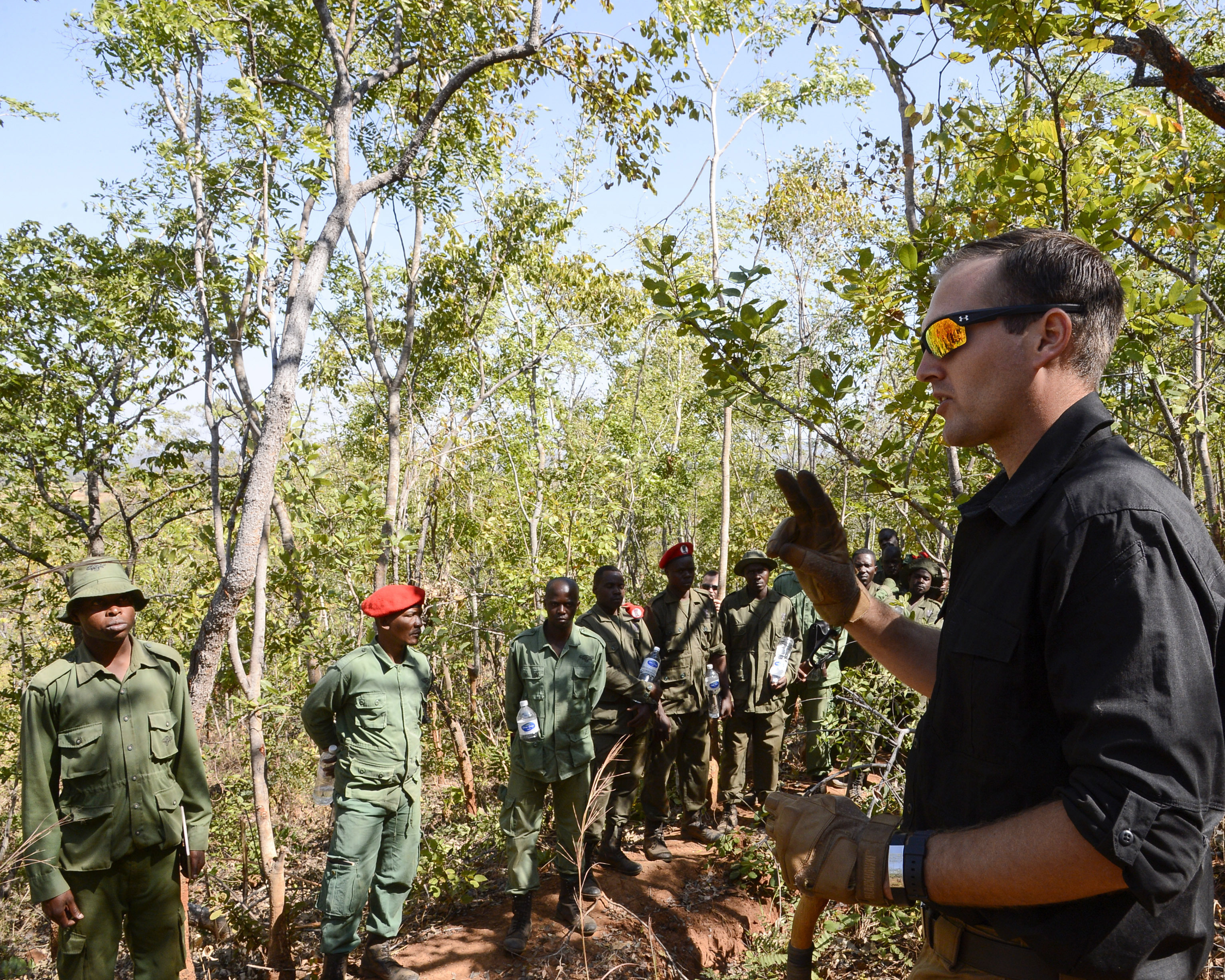 U.S. Army Sgt. Matthew Smith, with the 404th Civil Affairs Battalion, assigned to Combined Joint Task Force-Horn of Africa, conducts a practical exercise in ground surveillance for Tanzania Wildlife Management Authority (TAWA) patrol game wardens during a Counter Illicit Trafficking course, in Ngwala, Tanzania, July 24, 2018. The course provided by the 404th Civil Affairs Battalion is a month-long course to enhance TAWA's anti-poaching capabilities in Tanzania. (U.S. Navy Photo by Mass Communication Specialist 2nd Class Timothy M. Ahearn)