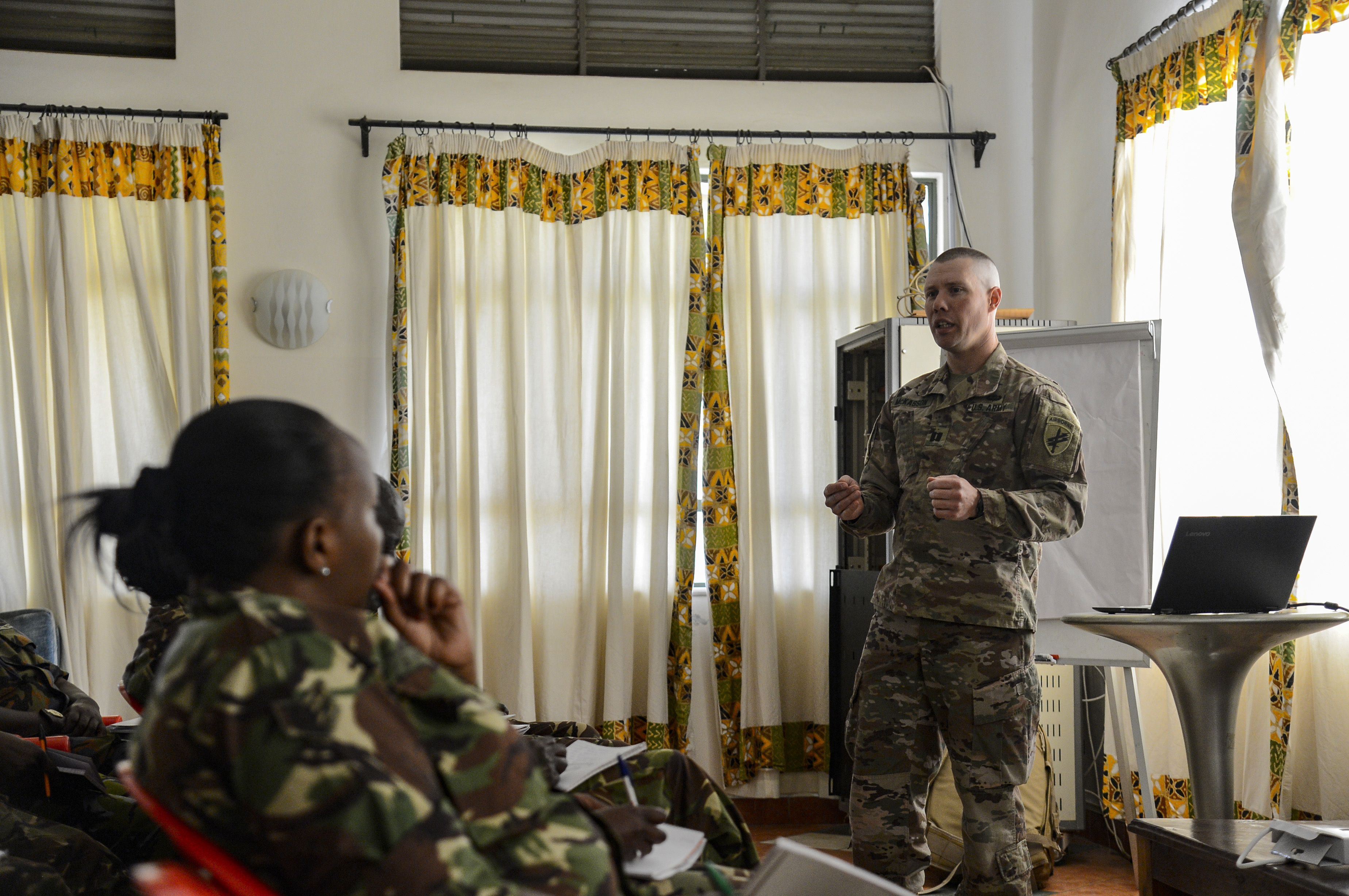 Army Capt. James McKasson, a veterinarian with the 404th Civil Affairs Battalion's Functional Specialty Team, explains how to take proper canine vital signs for members of the Kenyan Defense Force's 1st Canine Regiment during a Military Working Dog knowledge exchange, in Nairobi, Kenya, August 7, 2018. The exchange gave a chance for American and Kenyan forces to learn and work with each other to have a better understanding of each other's capabilities. (U.S. Navy Photo by Mass Communication Specialist 2nd Class Timothy M. Ahearn)
