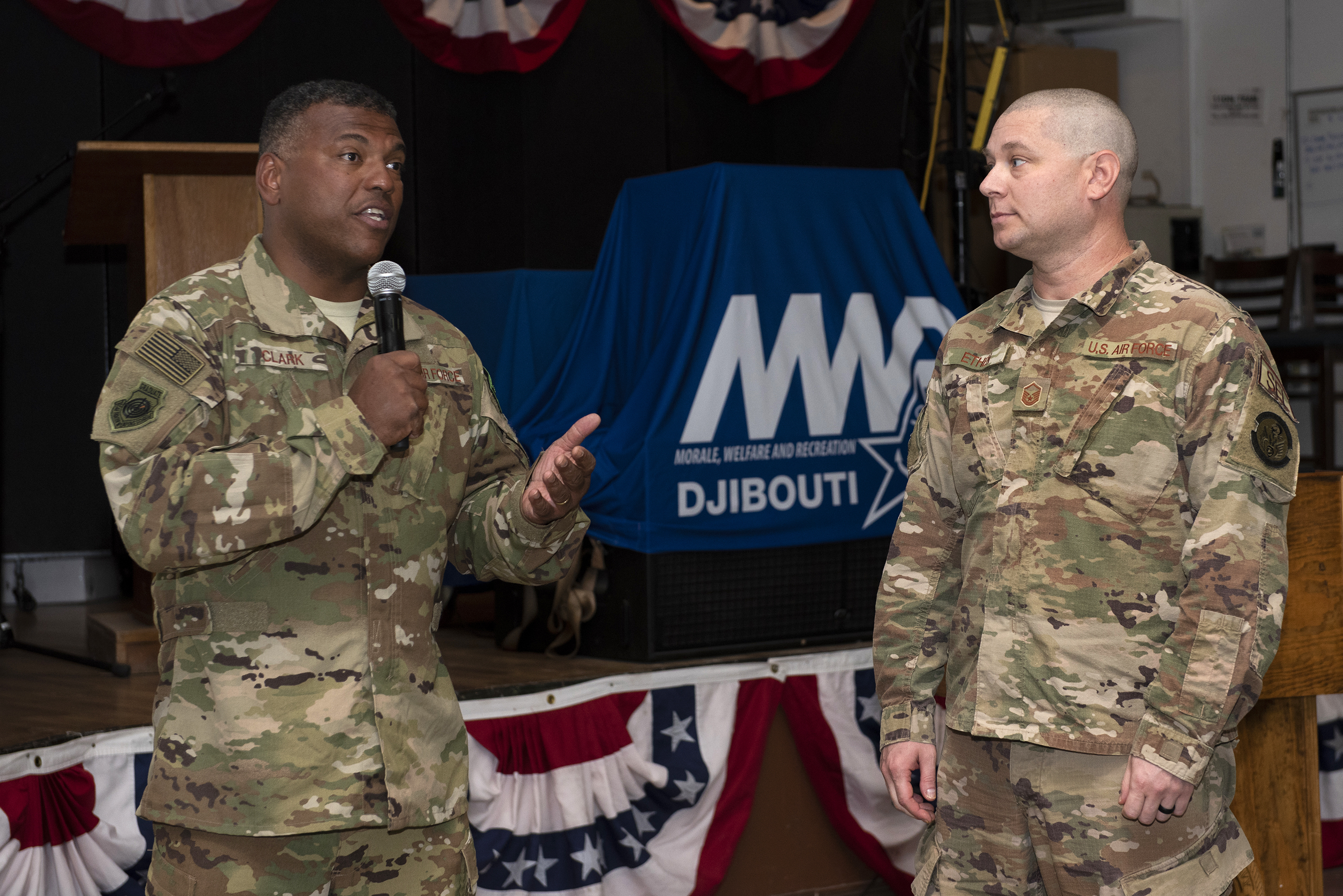 U.S. Air Force Lt. Gen. Richard Clark, commander, 3rd Air Force, recognizes the hard work and dedication of Master Sgt. David Ethen, munitions flight chief, 726th Expeditionary Air Base Squadron, 449th Air Expeditionary Group on Camp Lemonnier, Djibouti, Aug. 18, 2018. Ethen was identified as a top performer by his command and was recognized for his accomplishments during a visit from the 3rd Air Force's senior leadership. (U.S. Air National Guard photo by Master Sgt. Sarah Mattison)