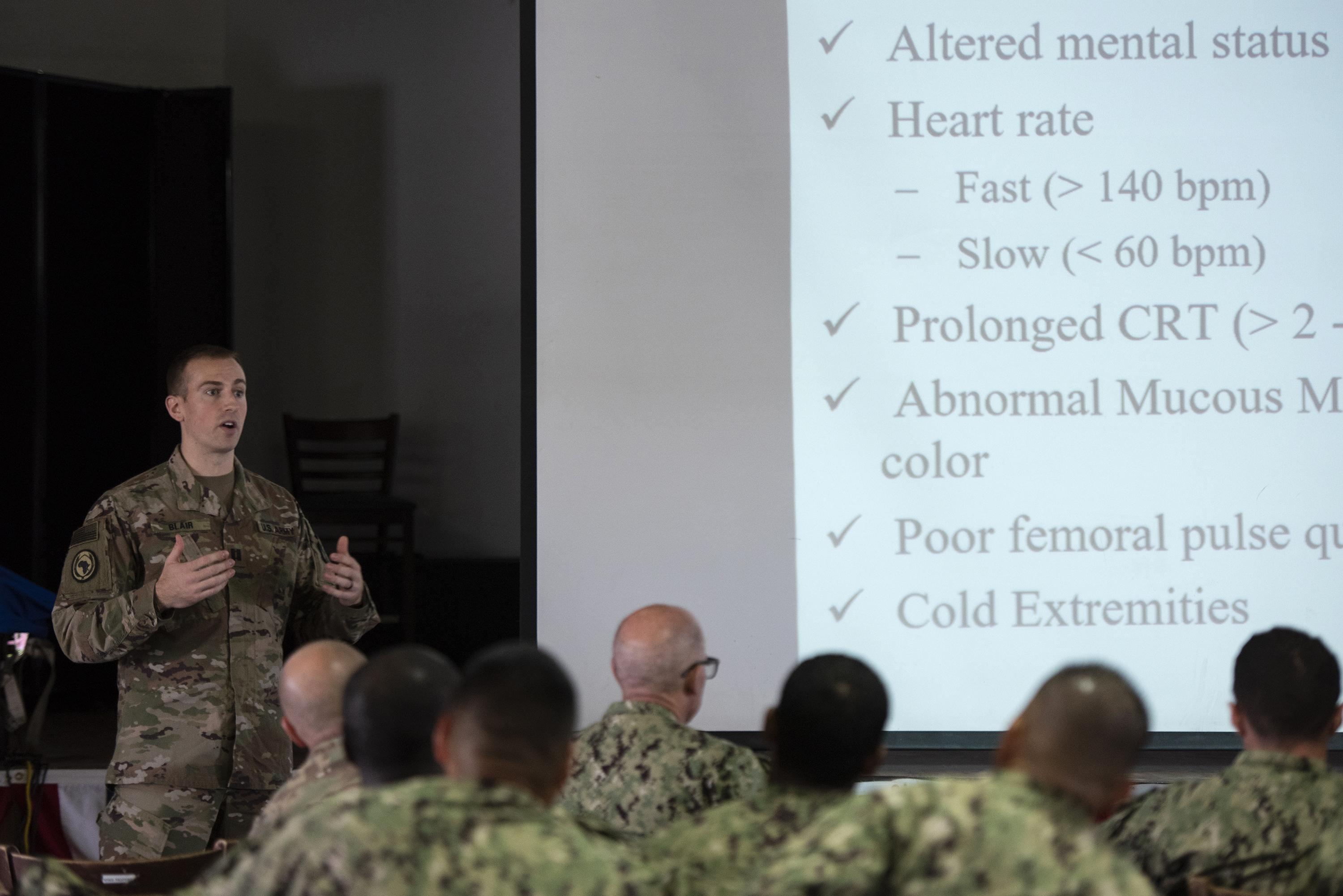 U.S. Army Cpt. Richard Blair, a veterinarian at Camp Lemonnier, teaches canine care techniques, on Camp Lemonnier, Djibouti, Aug. 18, 2018. Pelham was supporting a training event on canine tactical combat casualty care to help familiarize service members with medical backgrounds, on treating canines in the field. (U.S. Air National Guard photo by Master Sgt. Sarah Mattison)