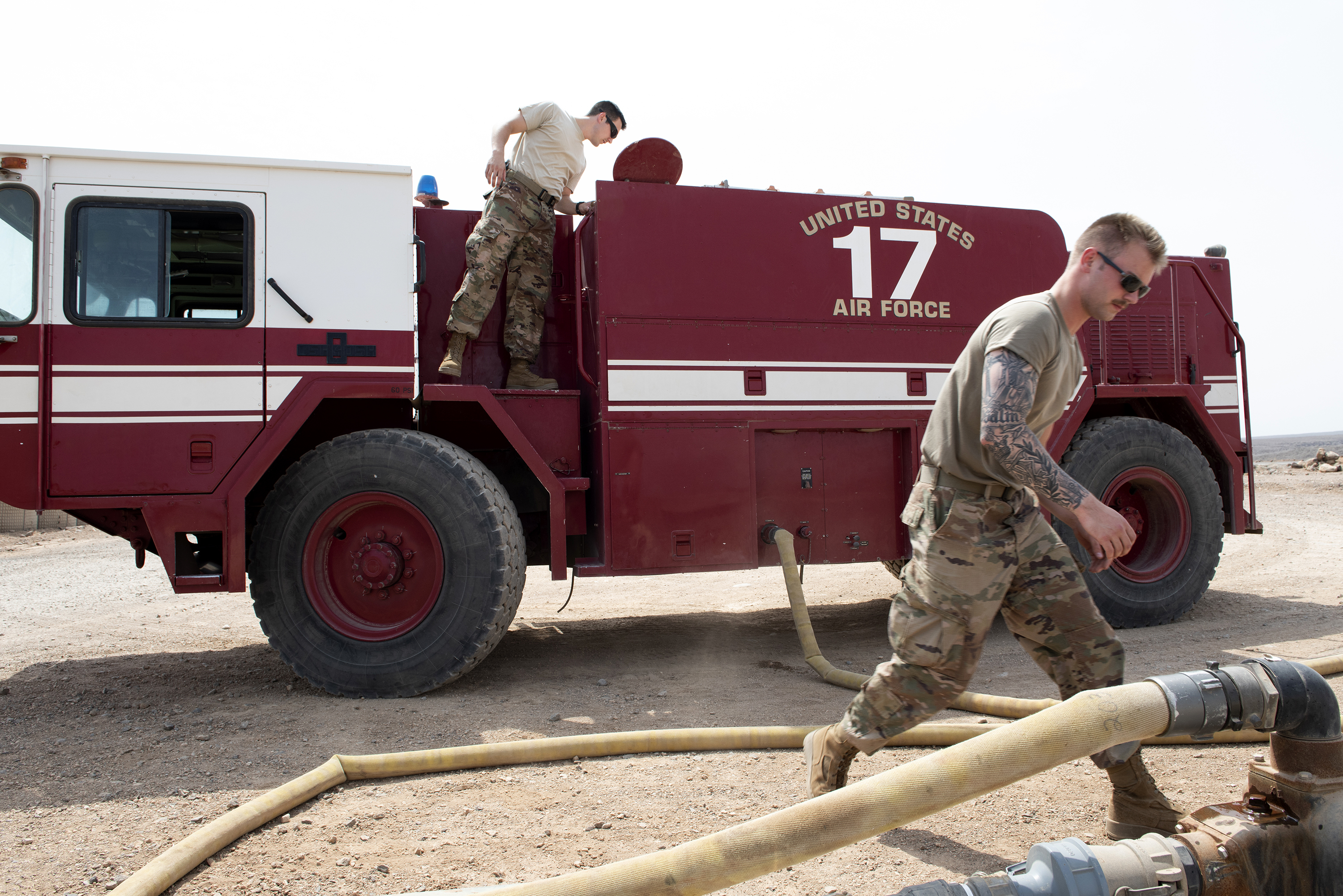 U.S. Air Force firefighters with the 449th Air Expeditionary Group and Combined Joint Task Force Horn of Africa fill the tank on a P-19B fire truck, outside Djibouti City, Djibouti, Aug. 20, 2018. The Airmen preform daily inspections on their trucks and equipment in order to maintain readiness. (U.S. Air National Guard photo by Master Sgt. Sarah Mattison)
