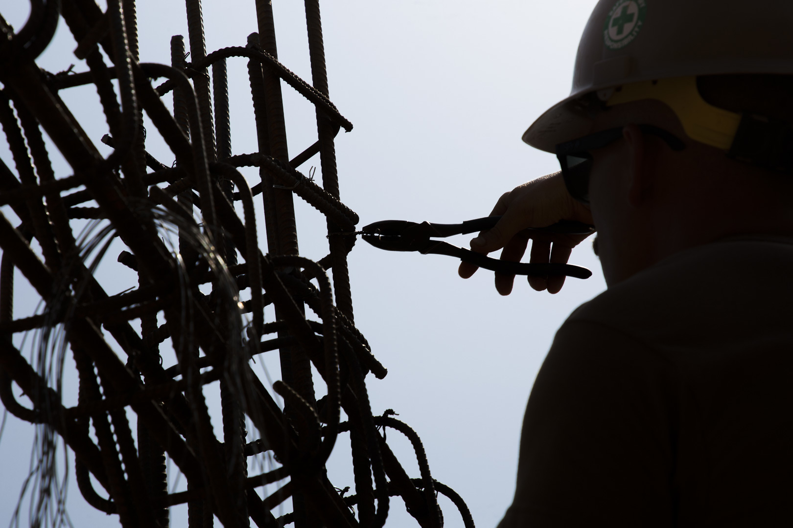 A U.S. Navy Seabee assigned to Naval Mobile Construction Battalion 1, Detachment Horn of Africa (NMCB 1 Det-HOA) ties in rebar at a construction site in Ali Oune, Djibouti, Sept. 19, 2018. NMCB-1, Det HOA is building a medical facility in Ali Oune in support of the Ministry of Health for Djibouti. (U.S. Air National Guard photo by Master Sgt. Andrew Sinclair)