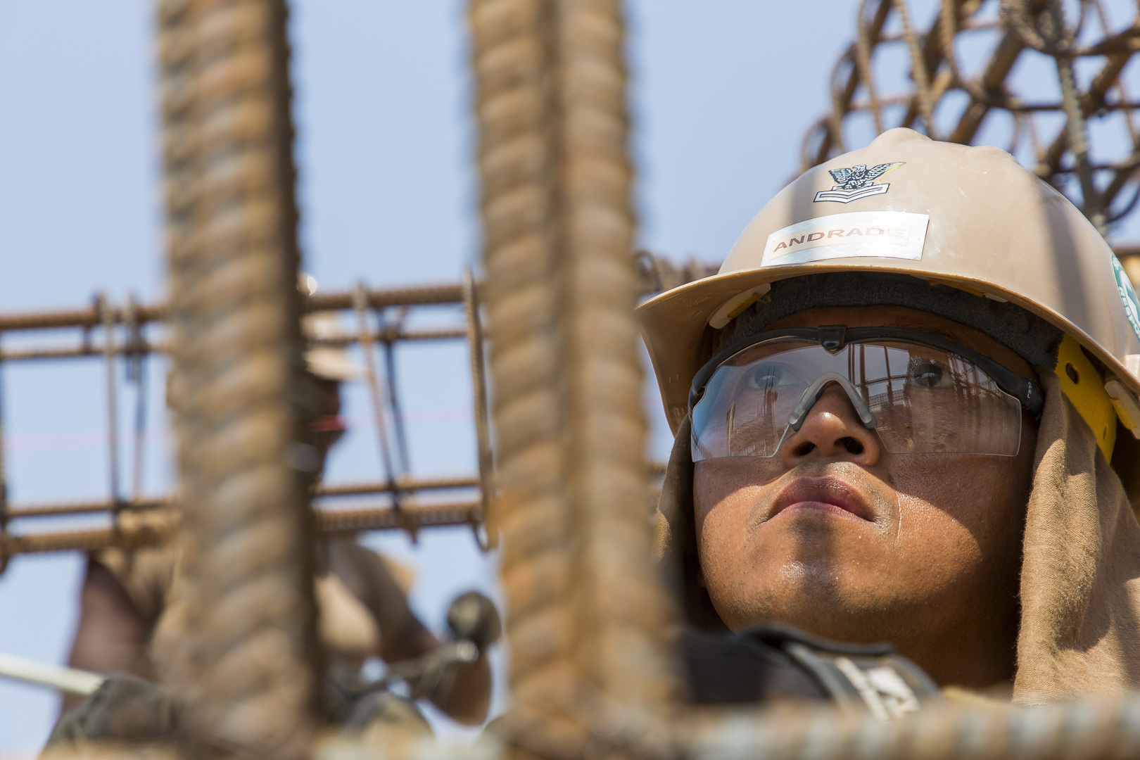 U.S. Navy Builder 2nd Class Gildardo Andrade, a Seabee assigned to Naval Mobile Construction Battalion 1, Detachment-Horn of Africa (NMCB 1, Det-HOA), observes rebar placement for new living quarters at the medical construction site in Ali Oune, Djibouti, Sept. 19, 2018. Seabees with NMCB 1, Det-HOA are building a medical facility in Ali Oune in support of the Ministry of Health for Djibouti. (U.S. Air National Guard photo by Master Sgt. Andrew Sinclair)
