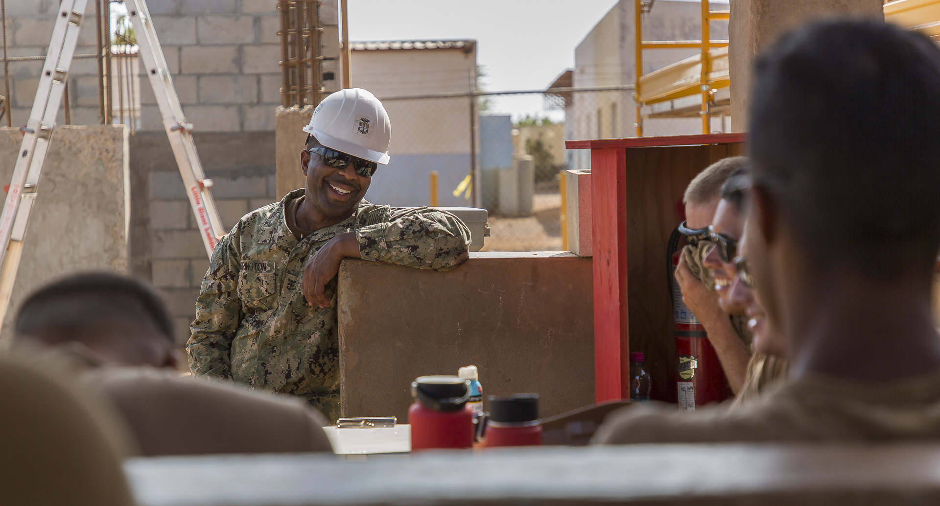 U.S. Navy Command Master Chief Derrick Arrington, Naval Mobile Construction Battalion 1 (NMCB 1) talks with Seabees assigned to a project site in Ali Oune, Djibouti, Sept. 19, 2018. NMCB 1 Detachment Horn of Africa is building a medical facility in Ali Oune in support of the Ministry of Health for Djibouti. (U.S. Air National Guard photo by Master Sgt. Andrew Sinclair)