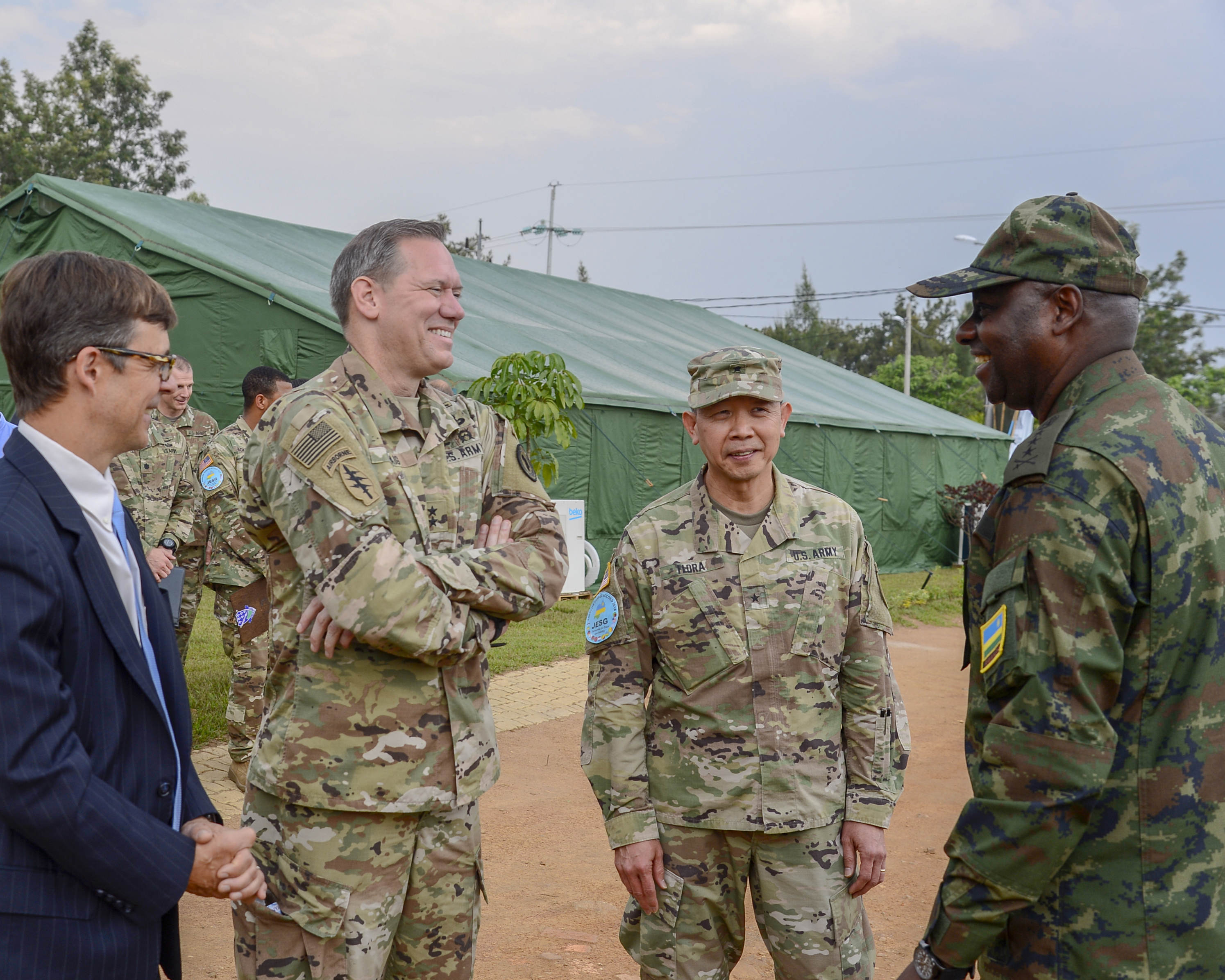 From left, U.S. Ambassador to Rwanda, the honorable Peter Vrooman, U.S. Army Maj. Gen. James Craig, commanding general of Combined Joint Task Force- Horn of Africa, Brig. Gen. Lapthe Flora, deputy commanding general of U.S. Army Africa, and Rwanda Defense Force Lt. Gen. Jacques Musemkaweli, Rwanda chief of defense, attend the closing ceremony of Shared Accord 2018, in Gako, Rwanda, Aug. 28, 2018. Craig visited Rwanda to conduct key leader engagements, meeting with both U.S. and Rwandan top leaders. (U.S. Navy Photo by Mass Communication Specialist 2nd Class Timothy M. Ahearn)