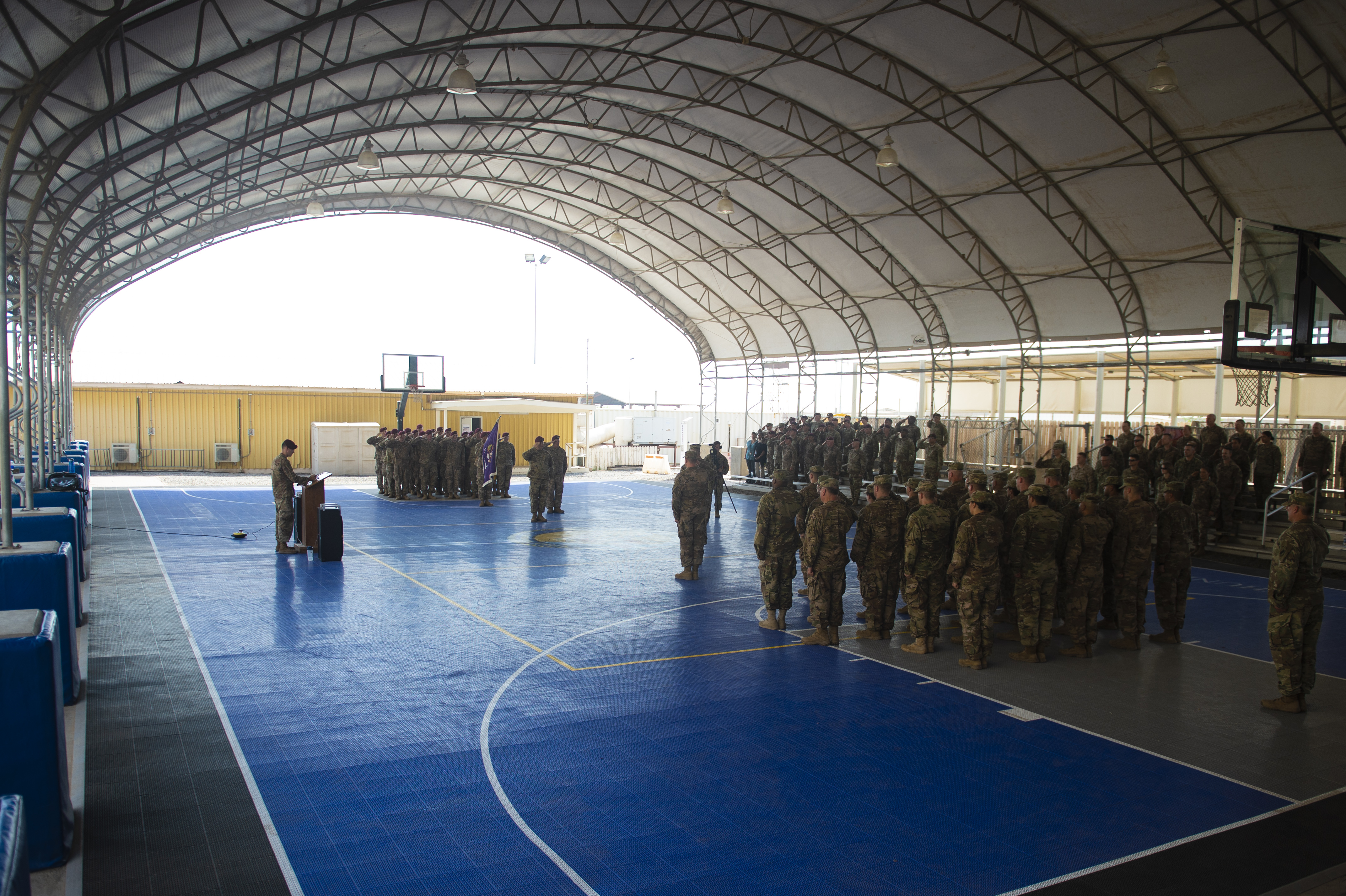 The 404th Civil Affairs Battalion and 403rd CA Battalion salute during the national anthem during a transfer of authority ceremony on Camp Lemonnier, Djibouti, Oct. 13, 2018. The 404th CA Battalion transferred its authority to the 403rd CA Battalion, who will now continue the mission throughout the Horn of Africa. (U.S. Air Force photo by Senior Airman Scott Jackson)