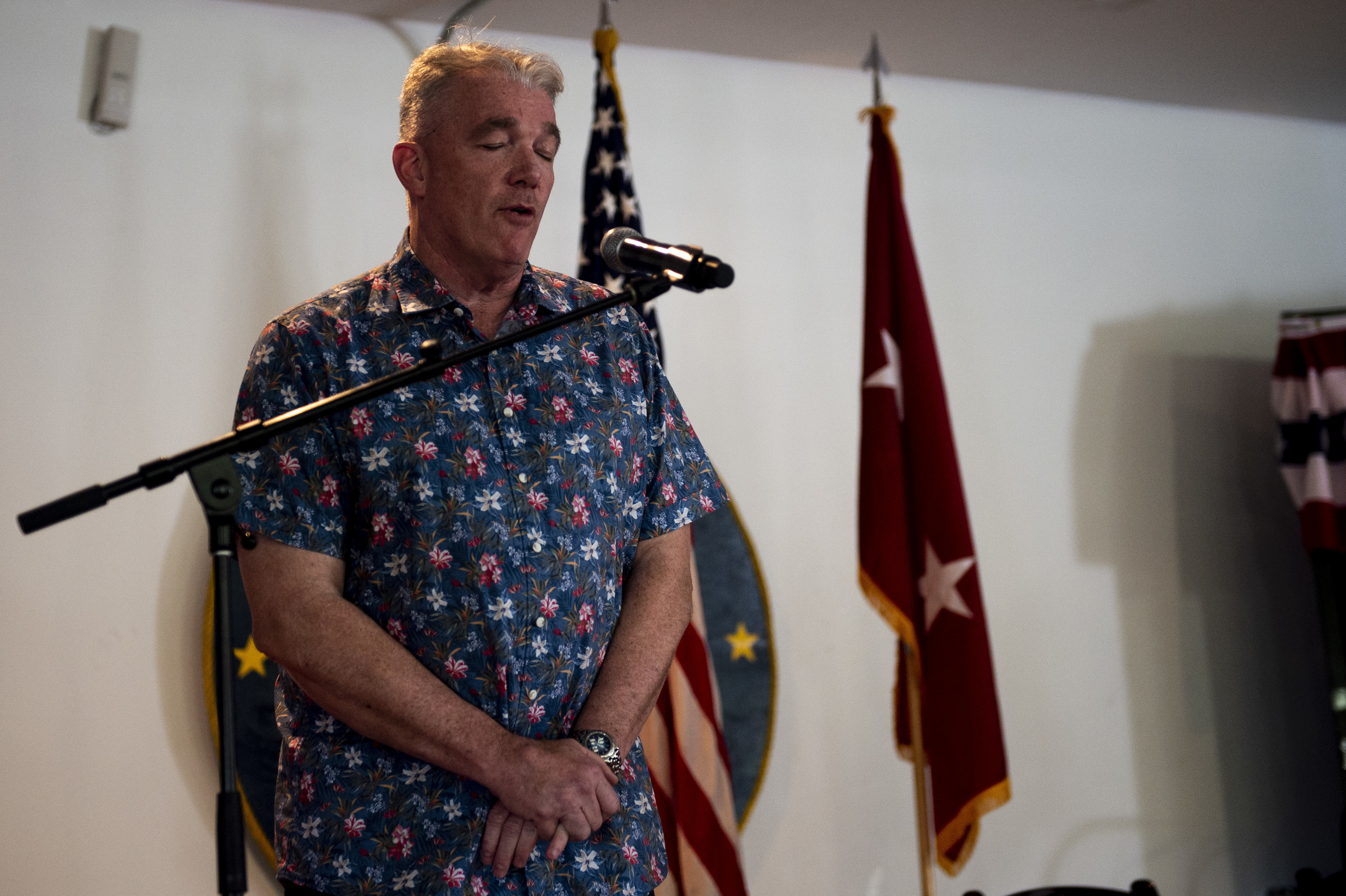 U.S. Navy Capt. Robert H. Carpenter, command chaplain for Combined Joint Task Force-Horn of Africa, leads prayer before lunch during a barbecue on Camp Lemonnier, Djibouti, Oct. 20, 2018. CJTF-HOA leadershp hosted the barbecue after an award ceremony that honored CJTF-HOA's three Service Members of the Quarter. (U.S. Air Force photo by Senior Airman Scott Jackson)