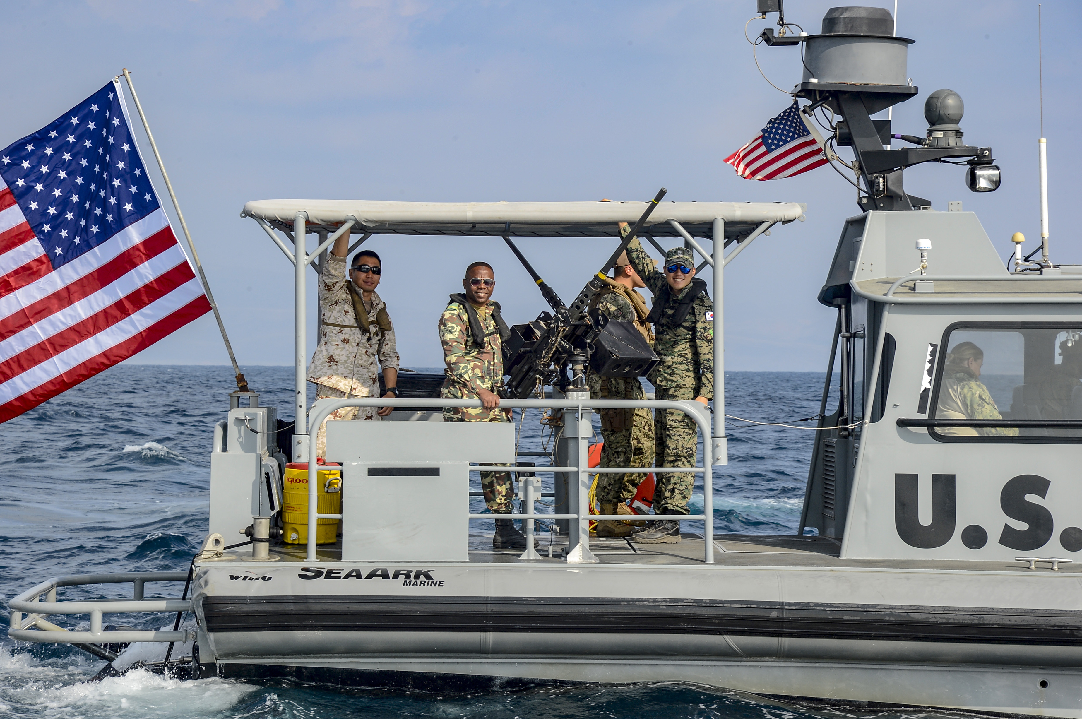 Foreign Liaison Officers (FLOs), assigned to Combined Joint Task Force-Horn of Africa (CJTF-HOA), pose for a photo during maritime security operations (MSO) with Coastal Riverine Squadron (CRS) 8 in the Gulf of Tadjourah, Oct. 23, 2018. CJTF-HOA FLOs observed the operations to better understand MSO and the CRS-8 mission. (U.S. Navy photo by Mass Communication Specialist 2nd Class Timothy M. Ahearn)