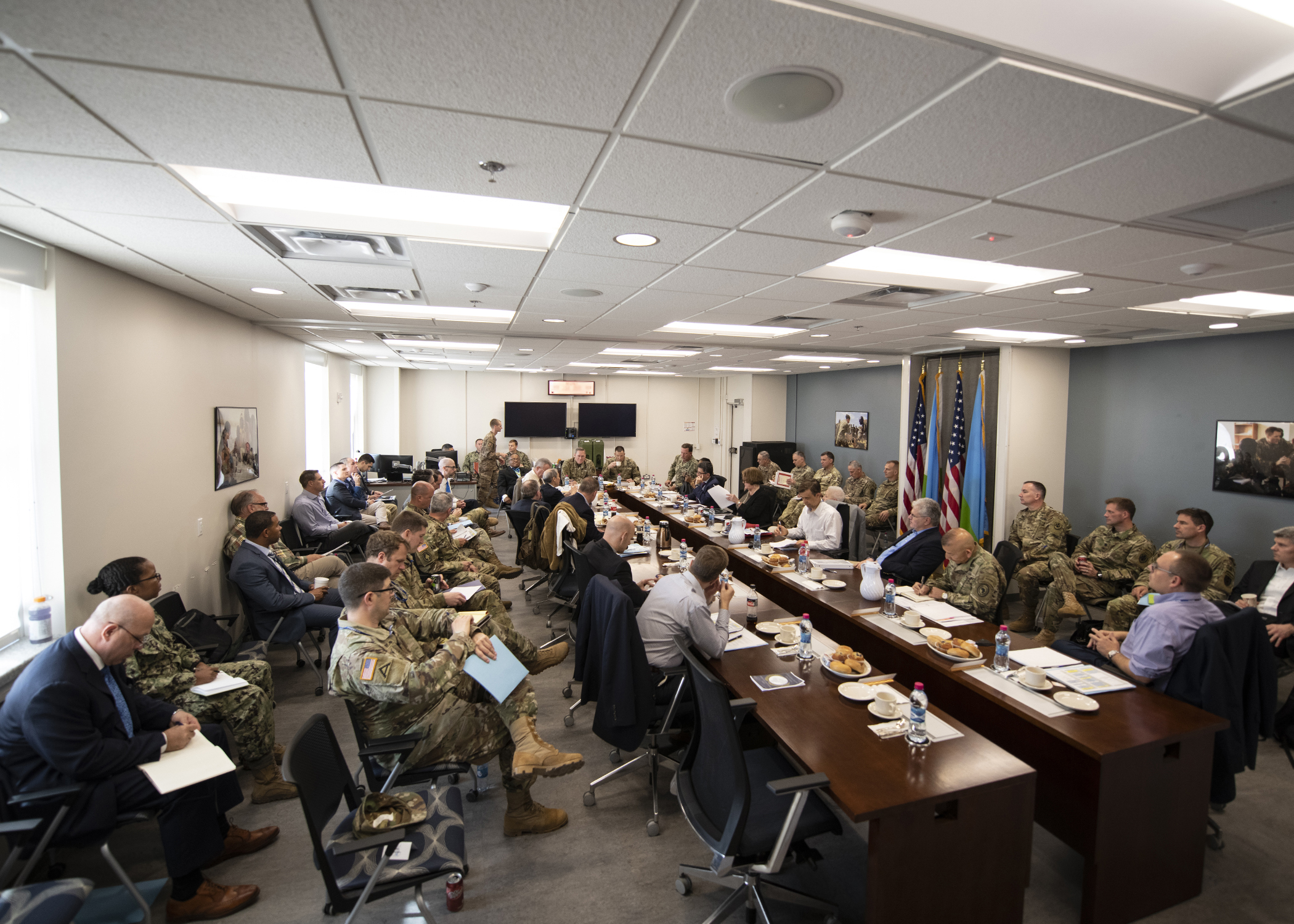 "U.S. Department of State and interagency officials attend a briefing titled ""Triggers of Regional Instability"" during the Combined Joint Task Force-Horn of Africa (CJTF-HOA) East Africa Security Forum (EASF) at Camp Lemonnier, Djibouti, Dec. 11, 2018. The EASF is an annual opportunity for CJTF-HOA and interagency leaders to sync, assess and align efforts to develop synchronized courses of action that support common goals. (U.S. Air Force photo by Tech. Sgt. Shawn Nickel)"