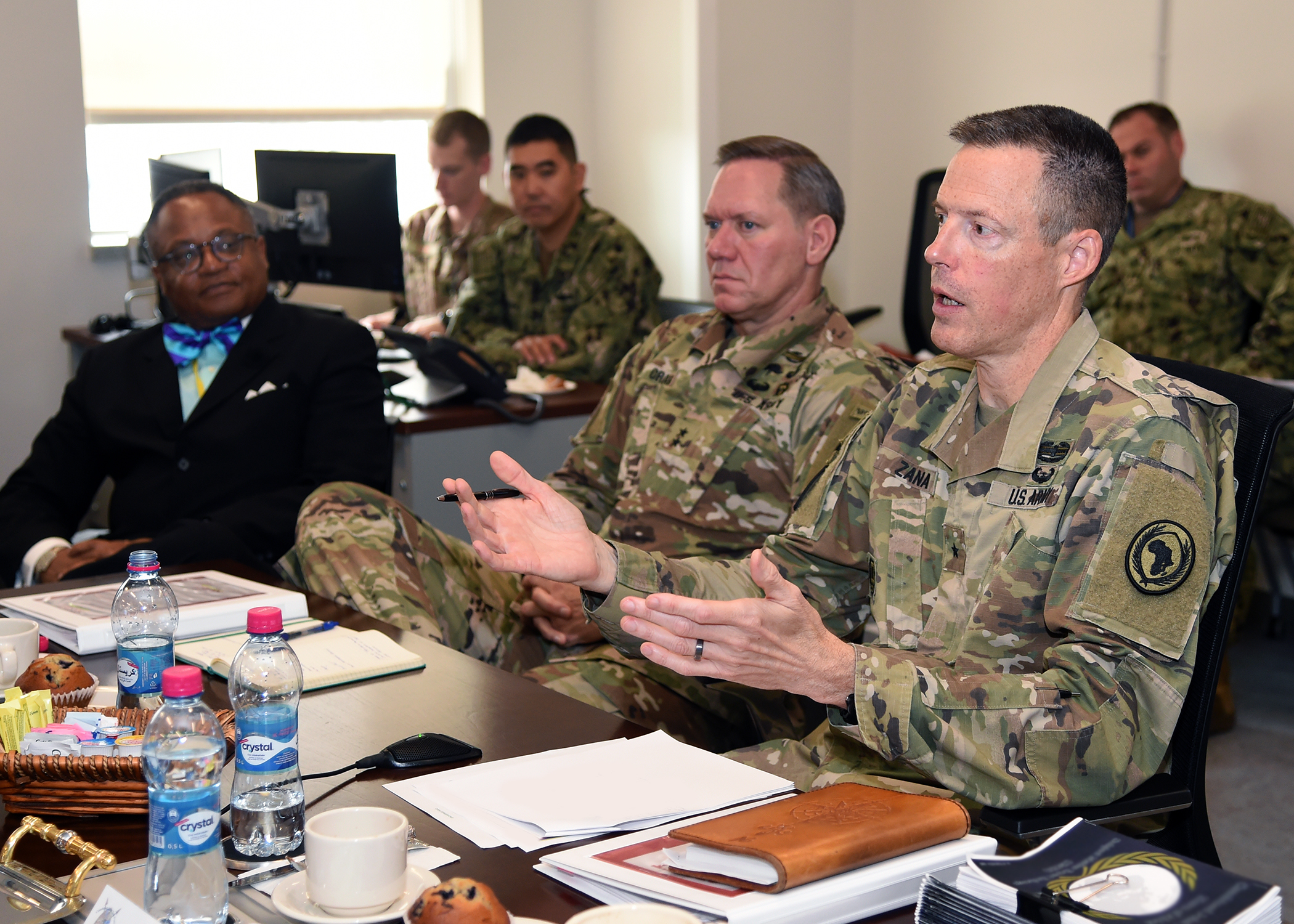 U.S. Army Maj. Gen. James D. Craig (center), commanding general, Combined Joint Task Force-Horn of Africa (CJTF-HOA), listens as U.S. Army Brig. Gen. William Zana (right), CJTF-HOA deputy commanding general, addresses U.S. diplomats at a meeting during the CJTF-HOA East Africa Security Forum (EASF) at Camp Lemonnier, Djibouti Dec. 12. The EASF provides opportunities for CJTF-HOA and interagency leaders to assess and align efforts, and develop synchronized courses of action that support common goals. (U.S. Navy photo by Mass Communication Specialist 1st Class Nick Scott)